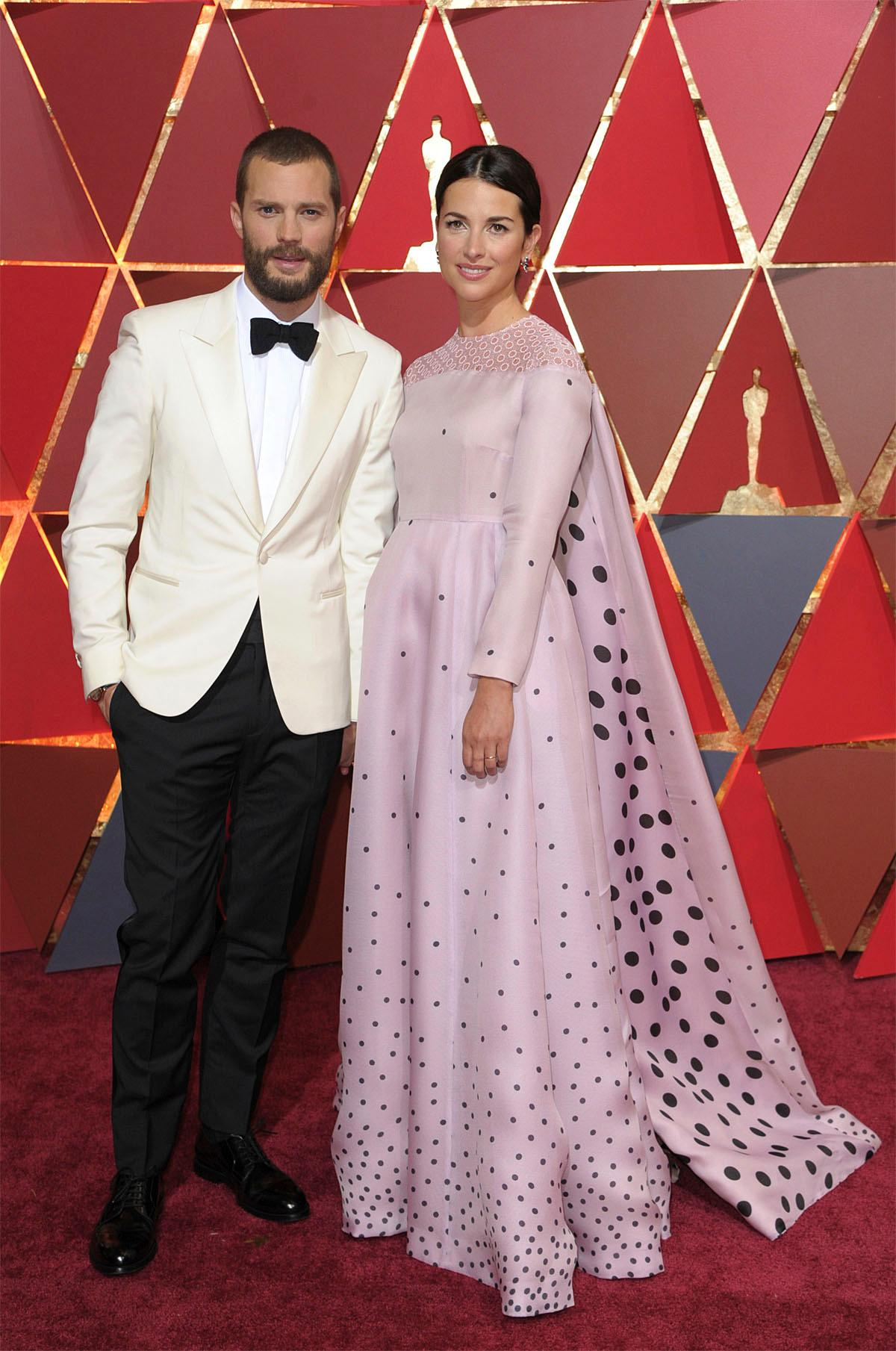 Jamie Dornan, left, and Amelia Warner arrive at the Oscars on Sunday, Feb. 26, 2017, at the Dolby Theatre in Los Angeles. (Photo by Richard Shotwell/Invision/AP)