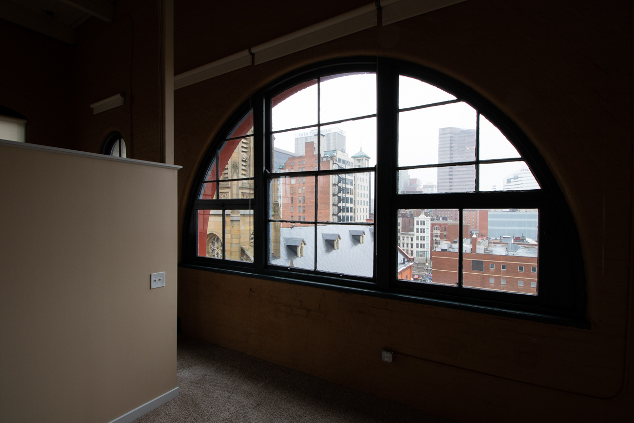 Unique arched windows on the top floor of Sycamore Place{ }/ Image: Ronny Salerno // Published: 2.6.19