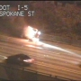Flipped car catches fire, bursts into flames on side of I-5