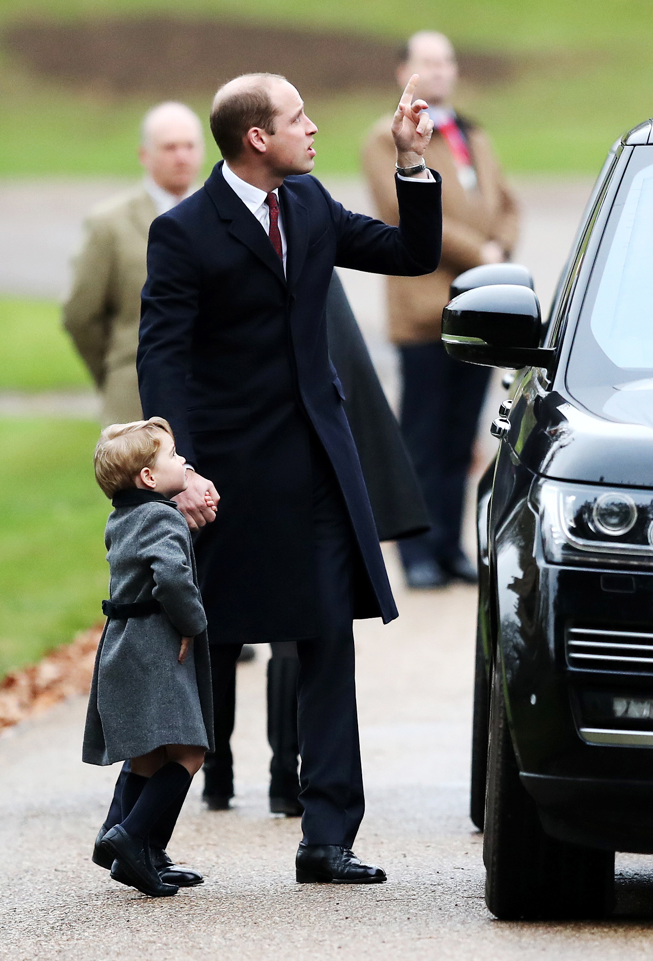 Britain's Prince William and Prince George, left, arrive to attend the morning Christmas Day service at St Mark's Church in Englefield, England, Sunday Dec. 25, 2016. A heavy cold is keeping Queen Elizabeth II from attending the traditional Christmas morning church service near her Sandringham estate in rural Norfolk, England. (Andrew Matthews/Pool via AP)