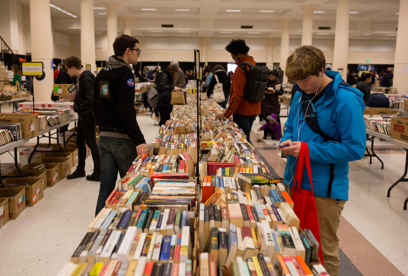 Thousands of book enthusiasts sort through some of the 100,000 titles for sale at the Big Book Sale 2017, put on by the Friends of The Seattle Public Library. (Sy Bean / Seattle Refined)