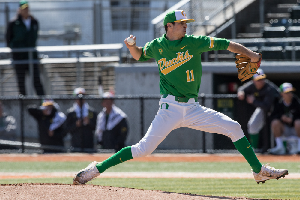 Oregon Ducks pitcher Matt Mercer (#11) throws a pitch.  In the second of the three game series, the Ducks beat the UC Irvine Anteaters 6-3. Photo by Austin Hicks, Oregon News Lab
