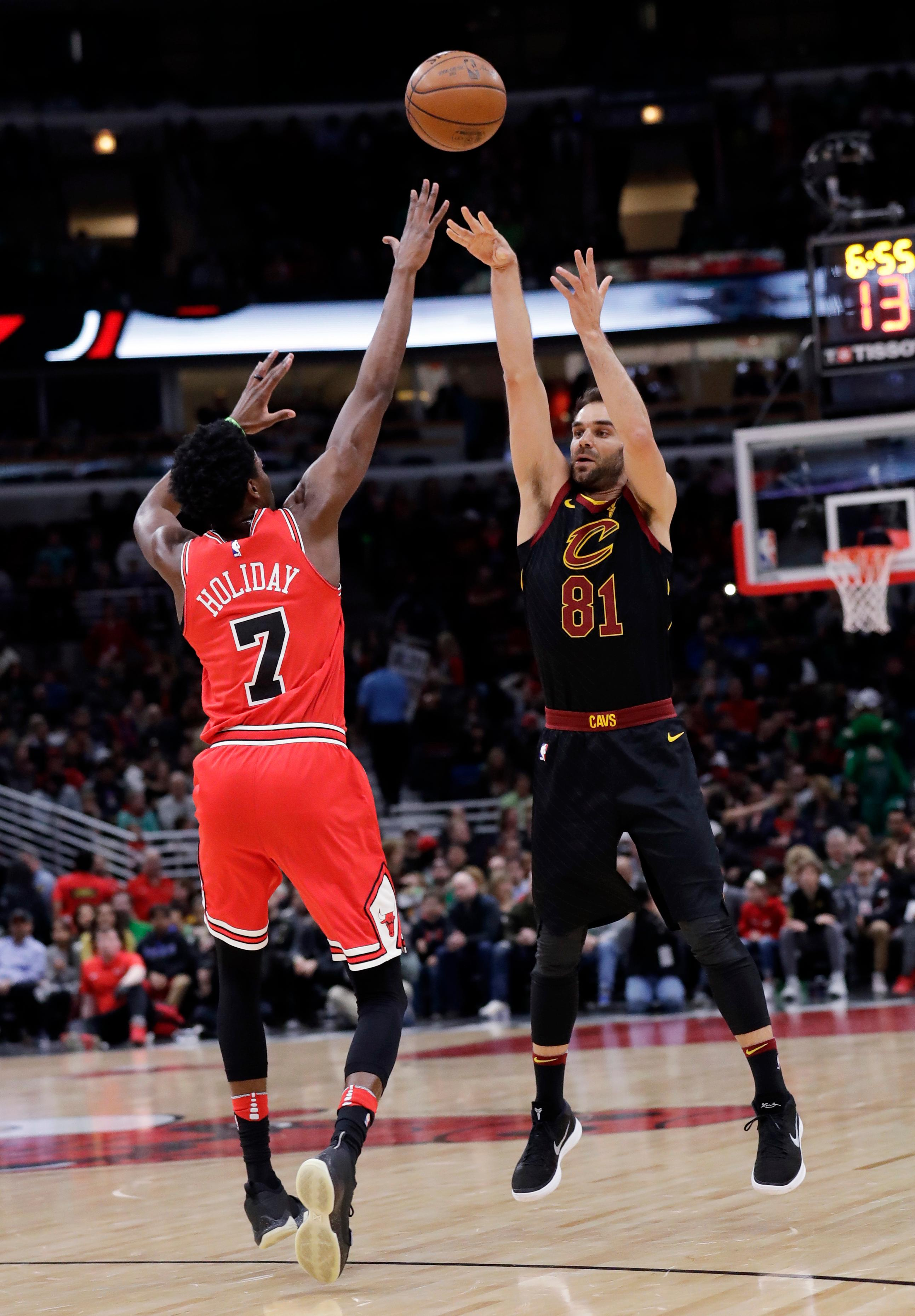 Cleveland Cavaliers guard Jose Calderon, right, shoots over Chicago Bulls guard Justin Holiday during the first half of an NBA basketball game Saturday, March 17, 2018, in Chicago. (AP Photo/Nam Y. Huh)