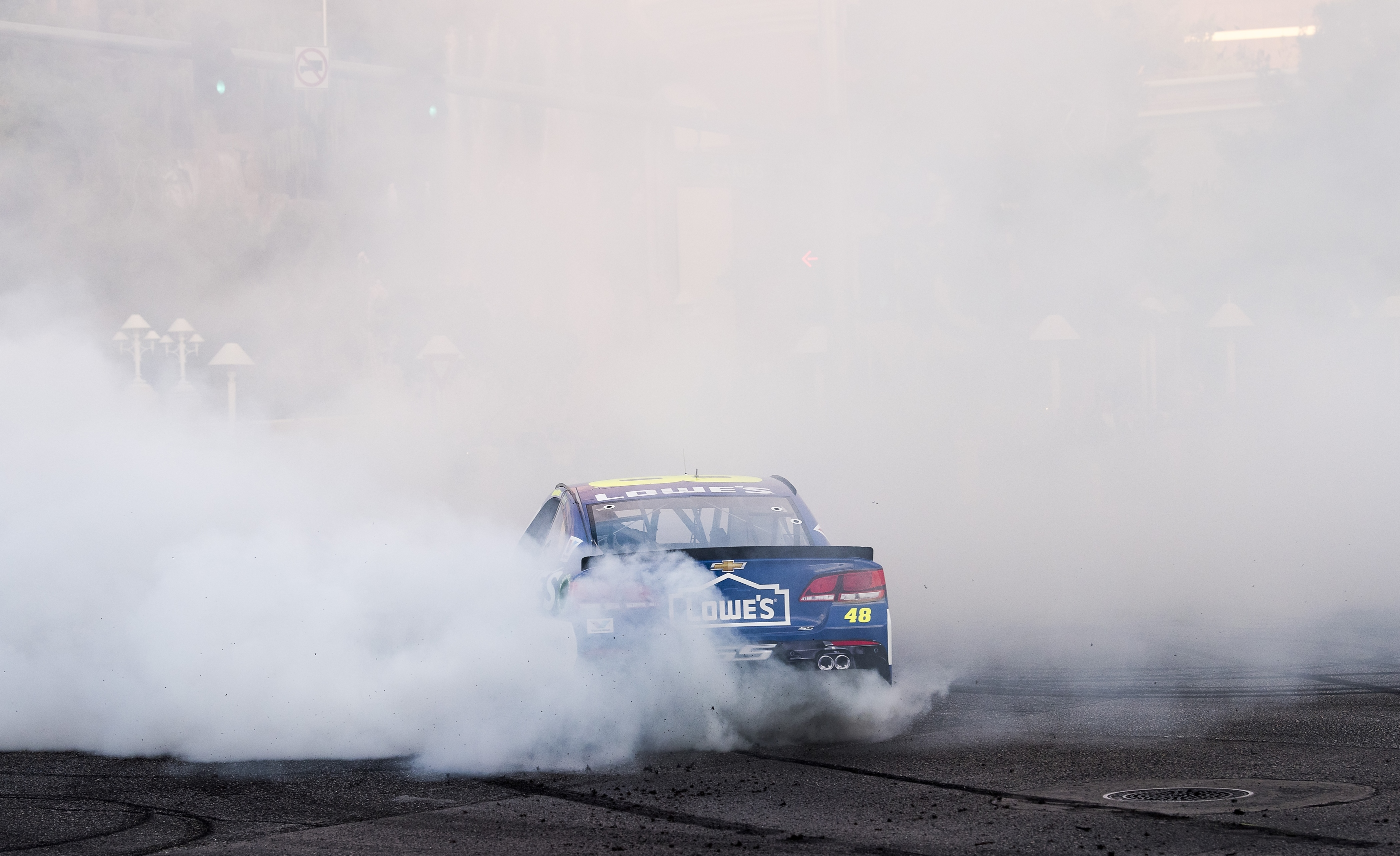 Jimmie Johnson and his #48 Hendrick Motorsports Lowe's Chevrolet SS is shrouded in smoke while burning out at the NASCAR Victory Lap on the Las Vegas Strip at the intersection of Las Vegas Blvd. and Spring  Mountain Road on Wednesday, Nov. 29, 2017. CREDIT: Mark Damon/Las Vegas News Bureau