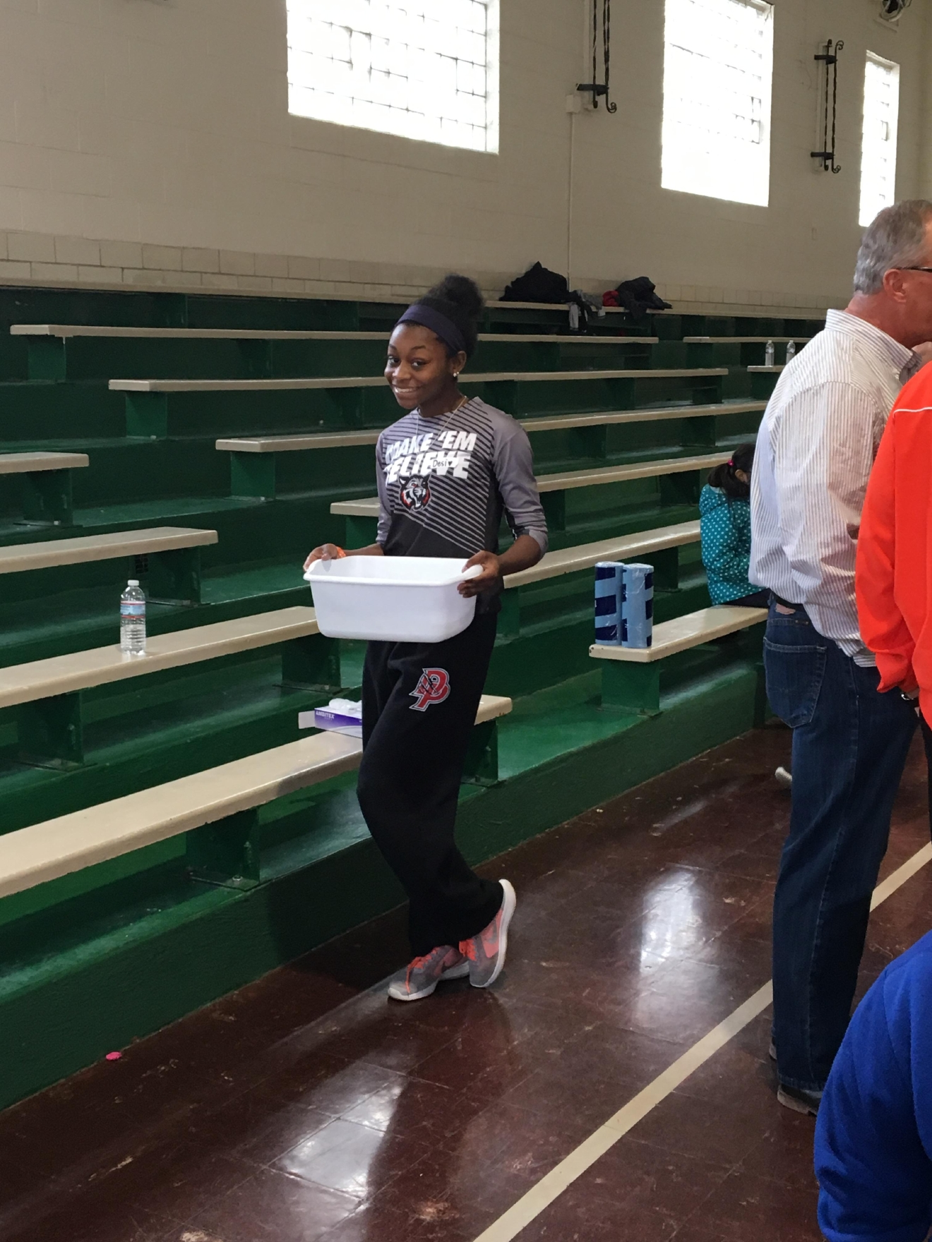 Local team raises money to provide people with shoes (Photo Courtesy of Coach Greg Taber)
