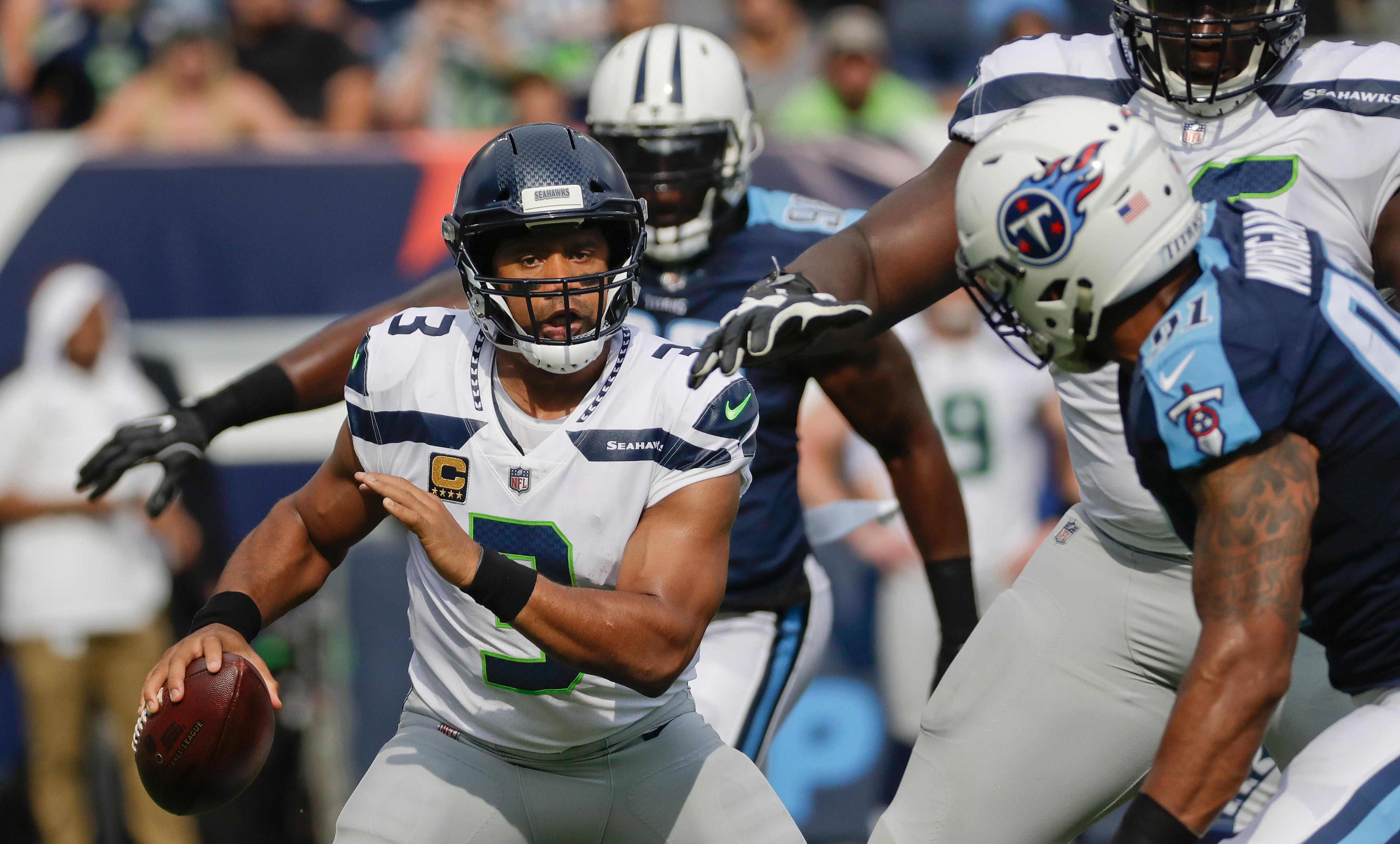 ... Seattle Seahawks quarterback Russell Wilson (3) is pressured by Tennessee  Titans outside linebacker Derrick Nike ... 50845b3af