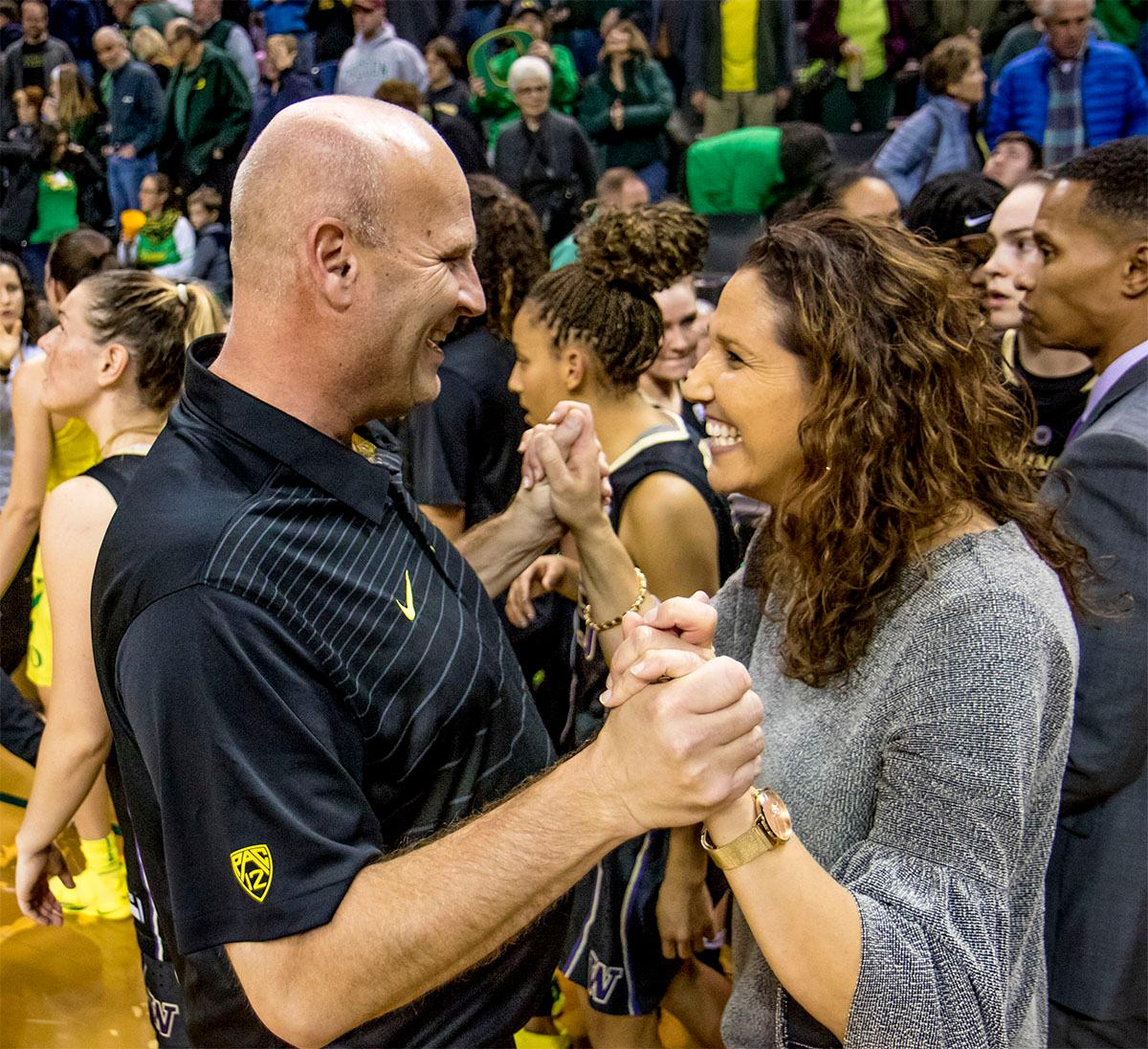 The Ducks Head Coach Kelly Graves is congratulated by the Huskies coach Jody Wynn on his 500th career win. The Oregon Ducks defeated the Washington Huskies 94-83 on Sunday at Matthew Knight Arena. Sabrina Ionescu also set the new NCAA all time record of 8 triple doubles in just 48 games. The previous record was 7 triple doubles in 124 games, held by Susie McConnell at Penn State. The Ducks will next face off against USC on Friday January 5th in Los Angeles. Photo by Rhianna Gelhart, Oregon News Lab