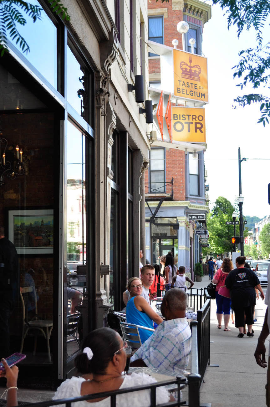 "PLACE: Taste of Belgium (OTR location) / ADDRESS: 1135 Vine Street (OTR) / EPISODE: Season 21, Episode 6: ""One Street Wonders"" / Belgium native, Chef Jean Francois Flechet melds the flavors of his childhood with a Midwest twist at this restaurant's five sites in Cincinnati. Follow in Guy's footsteps by visiting the OTR location to order the crispy, light, Belgian waffles and the Carbonnades (beef stew) poutine for a taste of Belgium in the Queen City. / Image courtesy of Taste of Belgium // Published: 8.18.19"