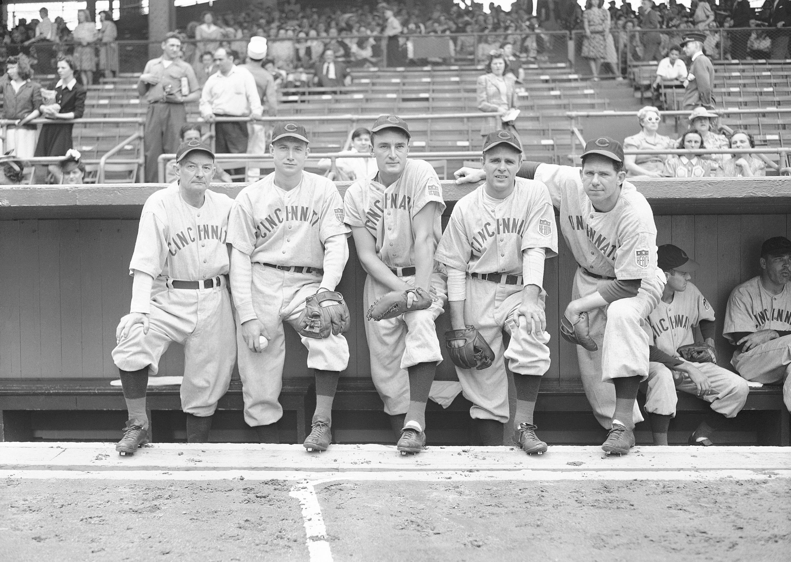 FILE - In this June 26, 1942 file photo, Cincinnati Reds All-Stars line up at Ebbets Field in Brooklyn, New York before a game with the Brook Dodgers. From left to right are Bill McKechnie; Bucky Walters, pitchers; Frank McCormick, first baseman; Johnny Vander Meer, pitcher, and Paul Derringer, pitcher. (AP Photo, File)