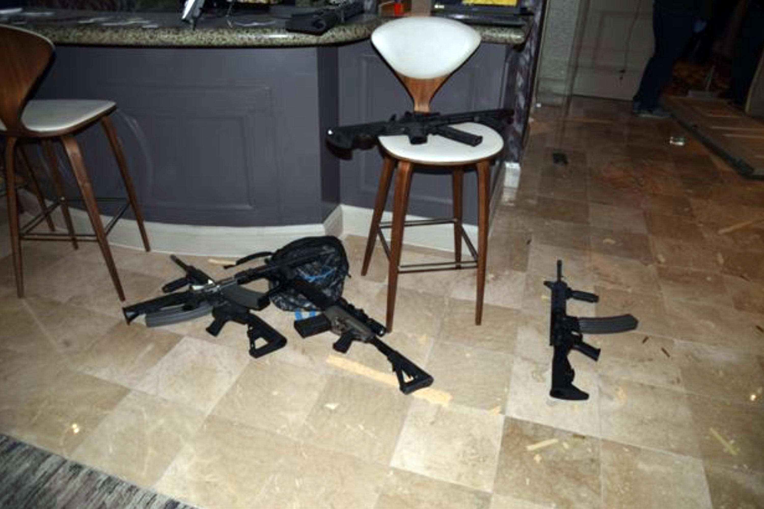 FILE - This October, 2017 file photo released by the Las Vegas Metropolitan Police Department Force Investigation Team Report shows the kitchenette in the hotel room of Las Vegas gunman Stephen Paddock's 32nd floor room of the Mandalay Bay hotel in Las Vegas, an image released as part of a preliminary report by Clark County Sheriff Joe Lombardo on Friday, Jan. 19, 2018, in Las Vegas. The name of a man identified in court documents as a person of interest in the deadliest mass shooting in modern U.S. history was publicly revealed because of a court error. Clark County District Court Judge Elissa Cadish said Tuesday, Jan. 30, 2018, that her staff failed to black out the name in nearly 300 pages of documents released to news organizations including The Associated Press and Las Vegas Review-Journal. (Las Vegas Metropolitan Police Department via AP, File)