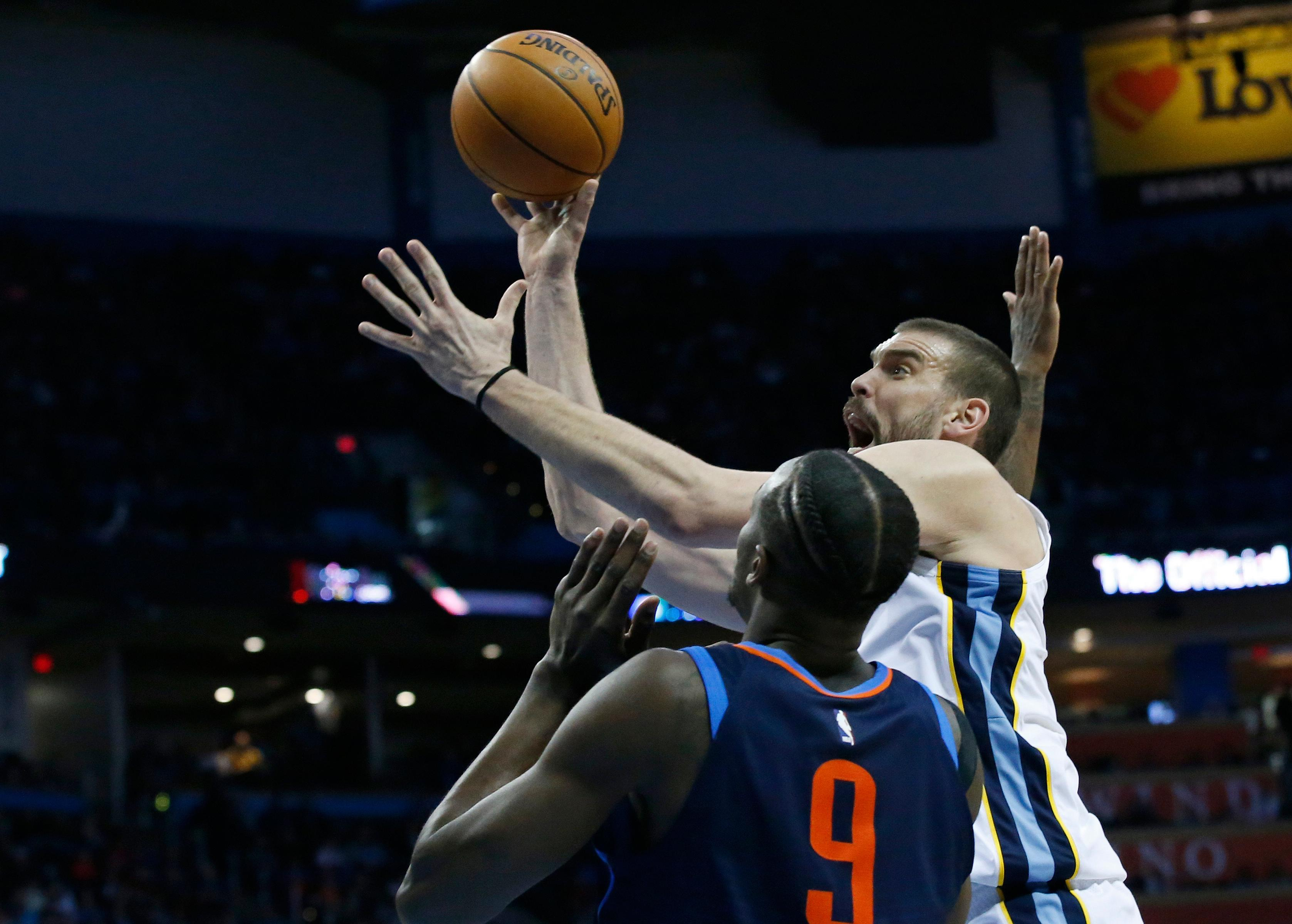 Memphis Grizzlies center Marc Gasol, right, shoots in front of Oklahoma City Thunder forward Jerami Grant (9) in the first half of an NBA basketball game in Oklahoma City, Sunday, Feb. 11, 2018. (AP Photo/Sue Ogrocki)