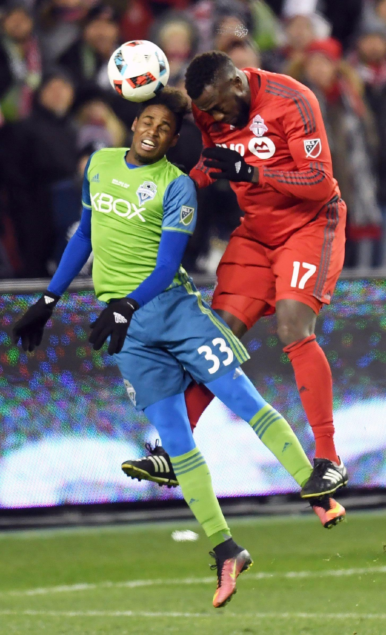 Toronto FC forward Jozy Altidore (17) heads the ball as Seattle Sounders defender Joevin Jones (33) defends during first-half MLS Cup final soccer action in Toronto, Saturday, Dec. 10, 2016. (Frank Gunn/The Canadian Press via AP)