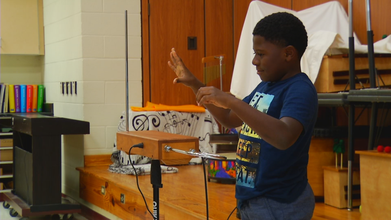 A grant from a mountain Rotary club is introducing Henderson County students to a new sound in music -- the theremin. (Photo credit: WLOS Staff)