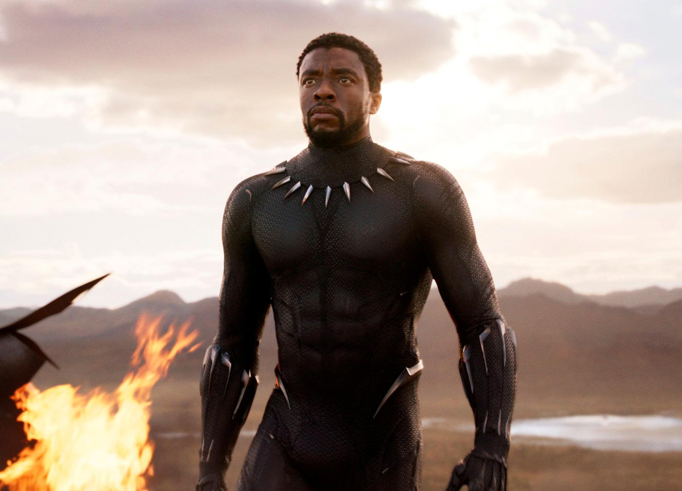 "This image released by Disney and Marvel Studios' shows Chadwick Boseman in a scene from ""Black Panther,"" in theaters on Feb. 16, 2018. As people gear up for the ""Black Panther"" movie, acclaimed author Ta-Nehisi Coates wants them to check out the original source, Marvel's Black Panther comic book, where he's booting up a massive outer space adventure for the king of Wakanda. (Marvel Studios/Disney via AP)"