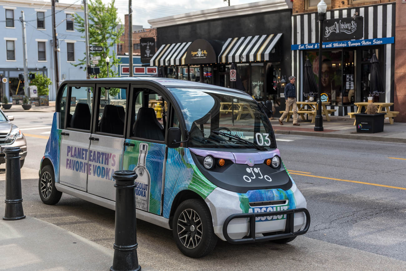 "Oggo (pronounced ""oh go"") is a safe and reliable transportation system that runs between Downtown, Covington, and Newport. Riders can hail an Oggo using a phone app, similar to Uber and Lyft. The 100 percent electric cars pick up riders and take them to sports games, concerts, bars, special events, or wherever else they want to go in the city's core, all while providing tours and highlighting local businesses from knowledgeable guides along the way. The app is available on Google Play and the Apple Store, and the service runs daily (and nightly) from 11 AM-10 PM. And the best part? The service is free. / Image: Mike Menke // Published: 5.7.19"