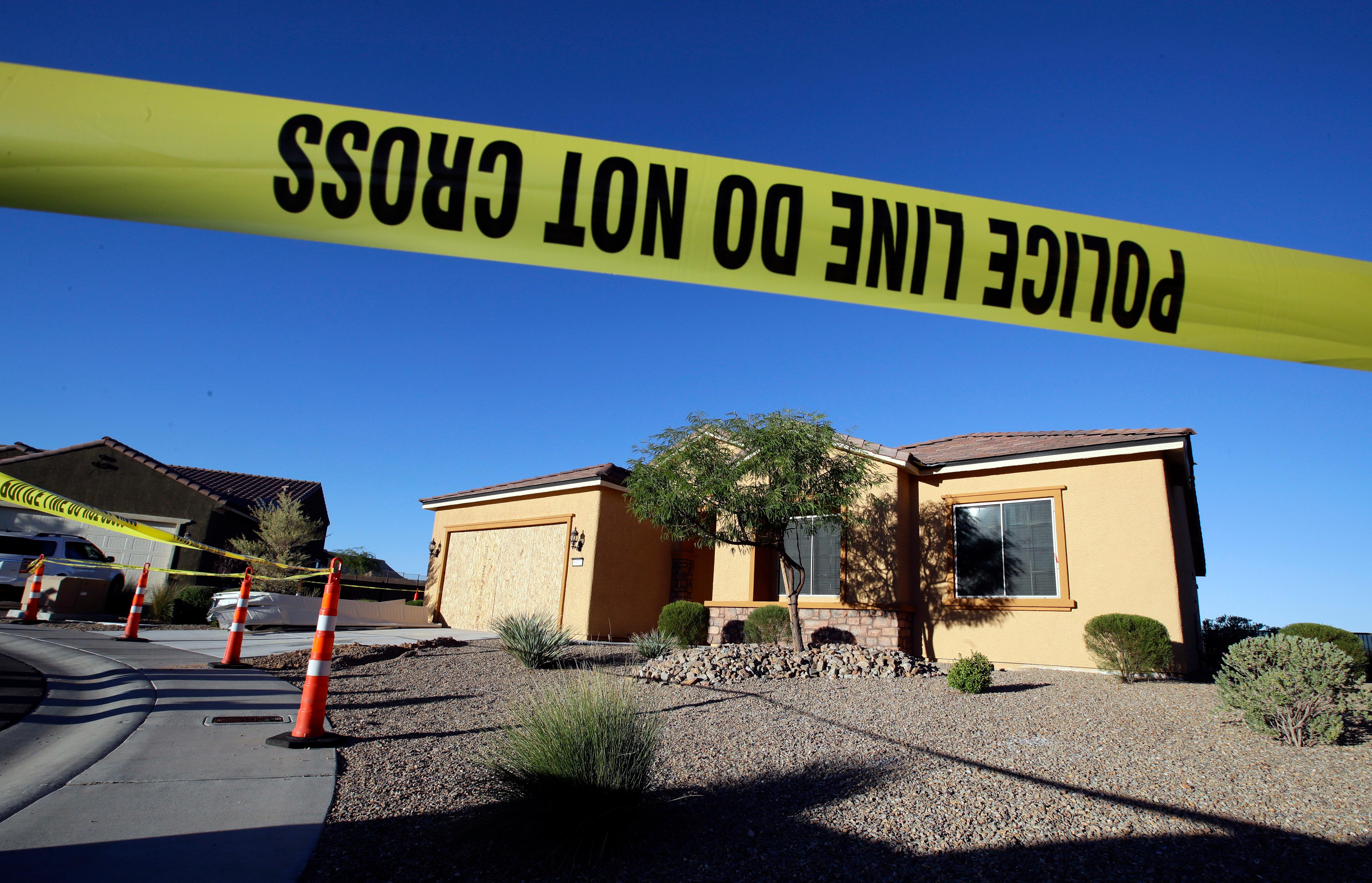 Police tape blocks off the home of Stephen Craig Paddock on Monday, Oct. 2, 2017, in Mesquite, Nev. Paddock killed dozens and injured hundreds on Sunday night when he opened fire at an outdoor country music festival in Las Vegas. Heavily armed police searched Paddock's home Monday. (AP Photo/Chris Carlson)