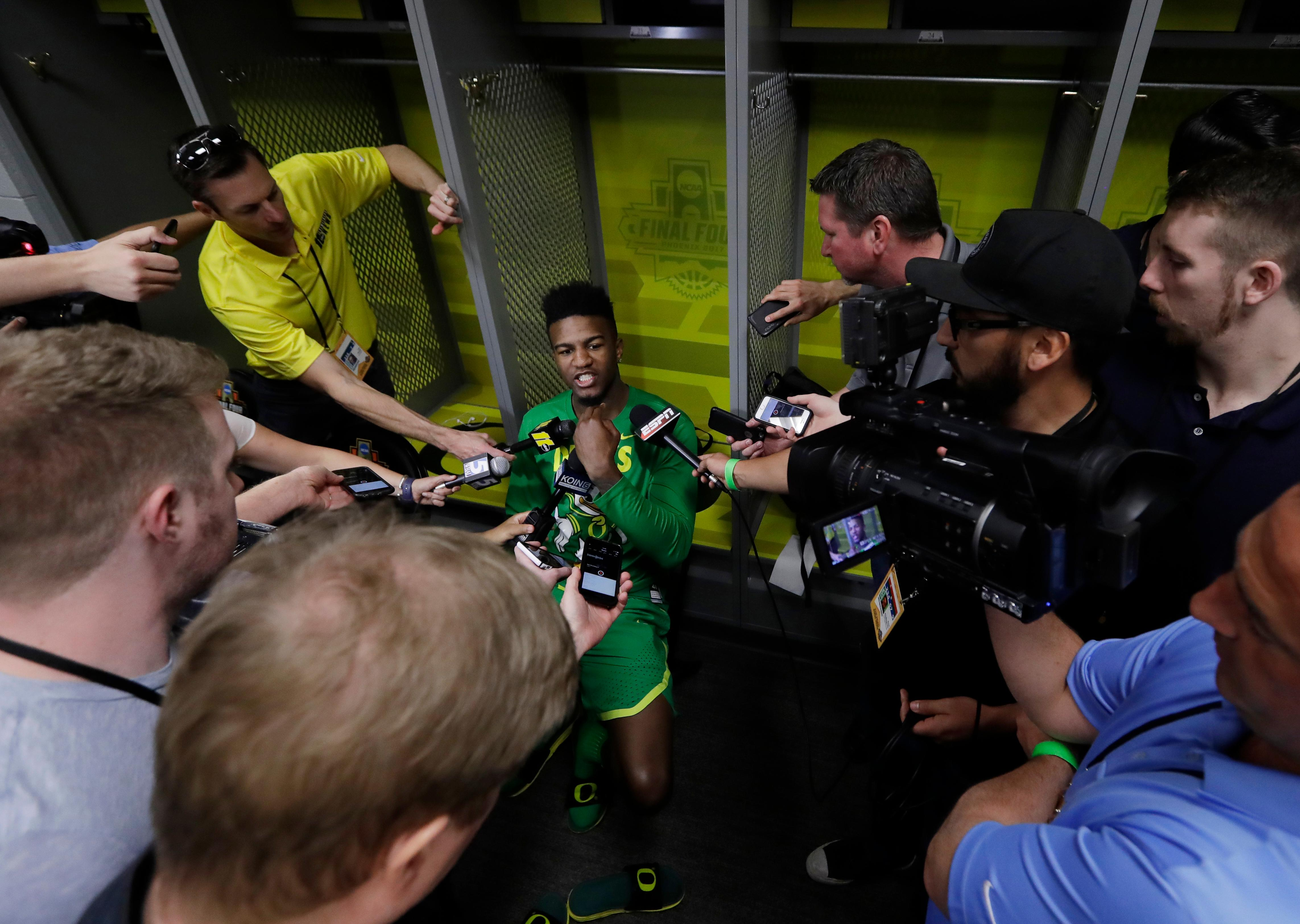 Oregon's Jordan Bell answers questions after a practice session for their NCAA Final Four tournament college basketball semifinal game Thursday, March 30, 2017, in Glendale, Ariz. (AP Photo/David J. Phillip)