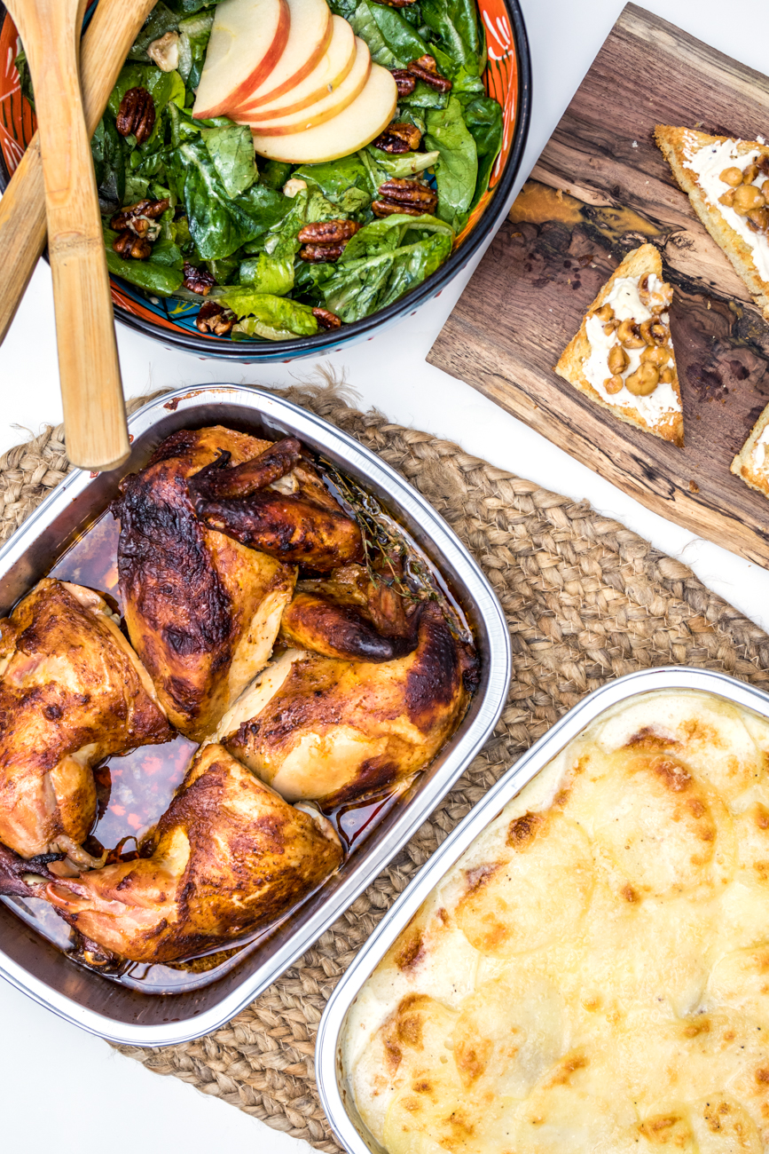 A la carte items from the Holiday Market including Sotto's goat cheese & hazelnut honey, Peruvian Whole Roasted Chicken, and Sotto's Chicory Salad and Creamy Au Gratin Potatoes / Image: Catherine Viox{ }// Published: 12.23.20