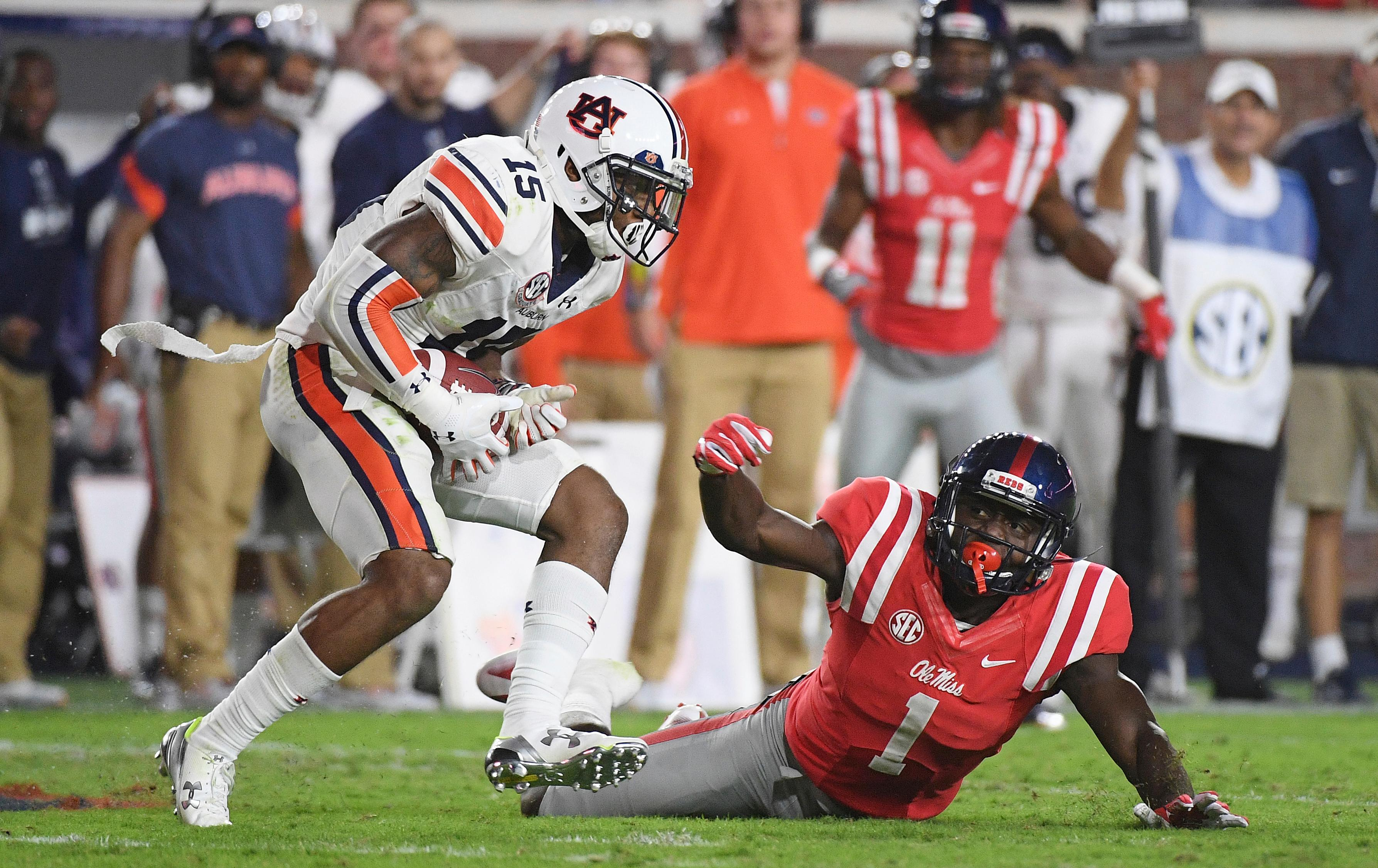 Auburn defensive back Joshua Holsey (15) was also taken in the seventh round by the Redskins. Holsey intercepts a pass intended for Mississippi wide receiver A.J. Brown (1) during the second half of an NCAA college football game in Oxford, Miss., Saturday, Oct. 29, 2016. No. 15 Auburn won 40-29. (AP File Photo/Thomas Graning)