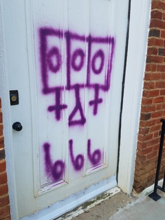 Four Airmen arrested after satanic messages are spray-painted on church