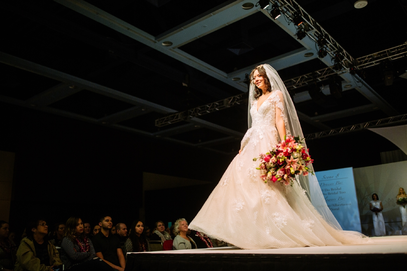 The 2017 Seattle Wedding Expo included a full wedding fashion show featuring different vendors and brands. The runway show highlighted some of the hottest wedding fashion style trends. (Joshua Lewis / Seattle Refined)