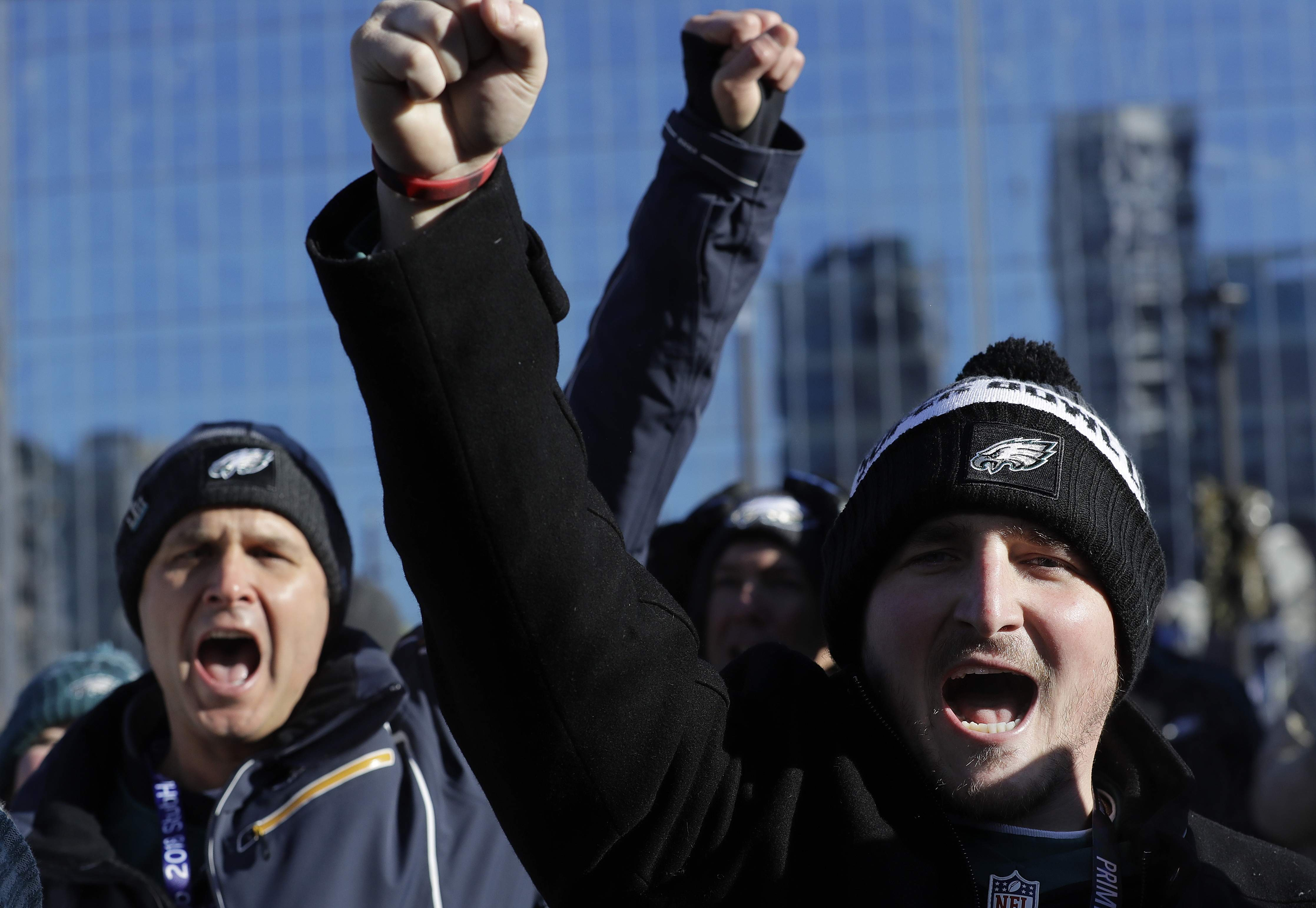Philadelphia Eagles fans cheer outside U.S. Bank Stadium before the NFL Super Bowl 52 football game against the New England Patriots Sunday, Feb. 4, 2018, in Minneapolis. (AP Photo/Eric Gay)