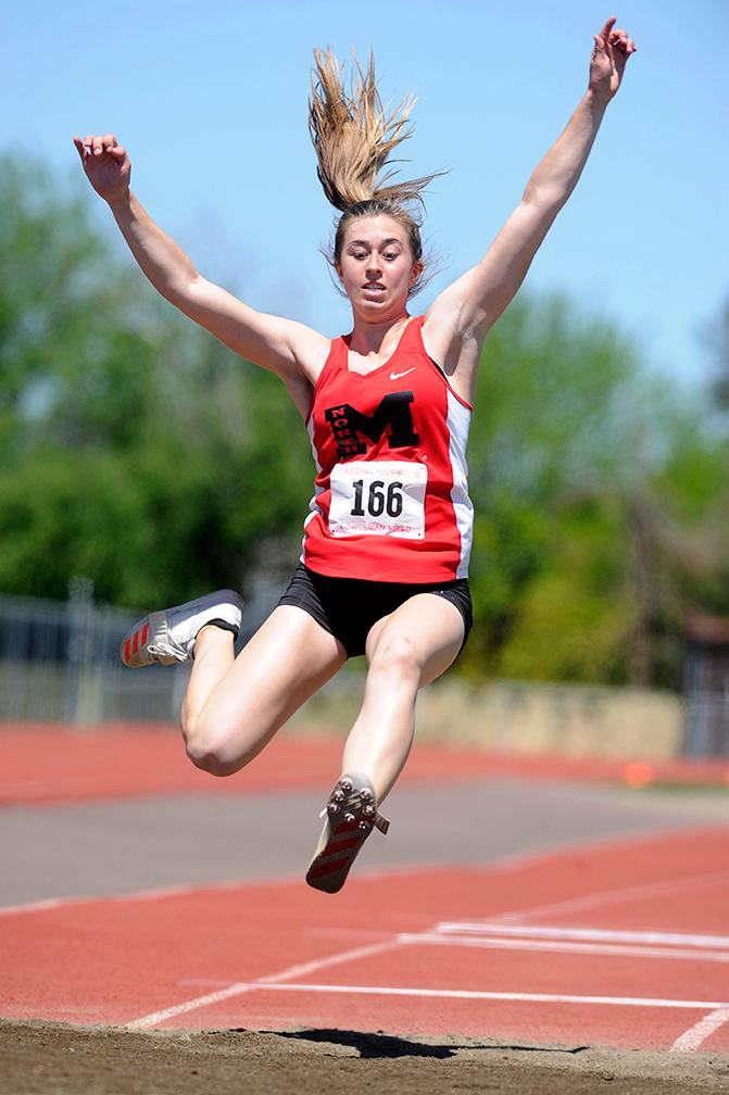 Andy Atkinson / Mail TribuneNorth Medford's Jane Ersepke makes a jump in the finals of the triple jump at the SWC Championships meet at North Medford High School Saturday.