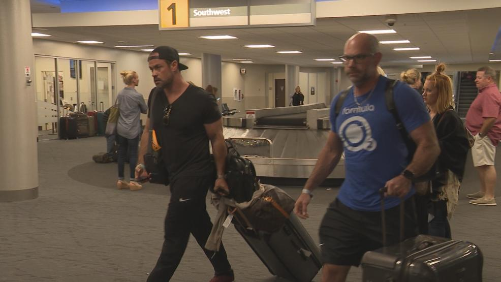 Central Ohioans who survived the deadliest mass shooting in modern American history returned home at John Glenn International Airport Monday.(WSYX/WTTE)