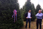 Timothy Harleth, chief usher for the White House (left), discusses the tree chosen as the Blue Room Christmas tree with Jim Chapman of Silent Night Evergreens, Sept. 25, 2017, at Hanauer's Tree Farms in Shawano County.