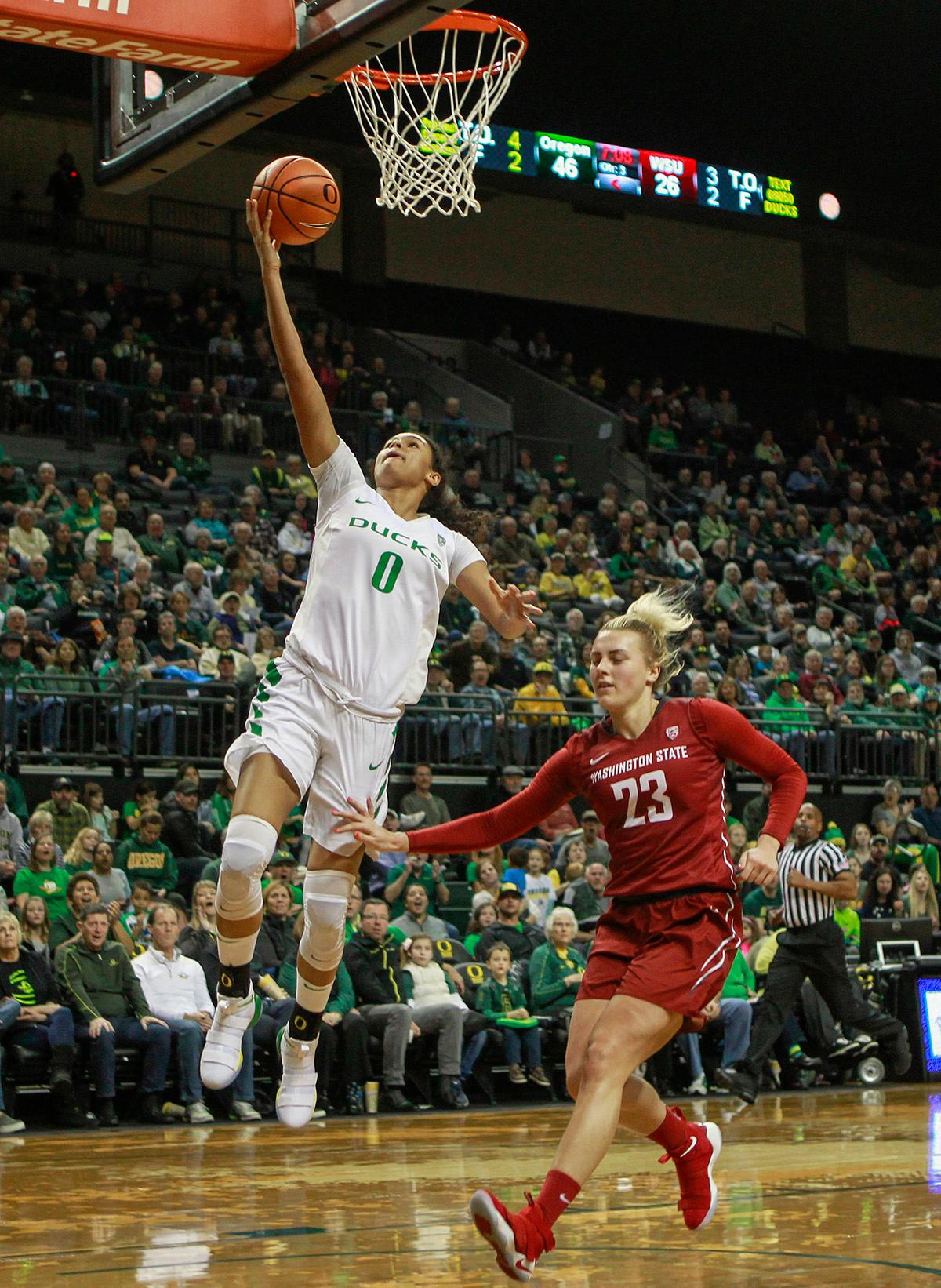 Oregon Ducks Satou Sabally (#0) goes in for a layup as Washington State University Cougars Alexys Swedlund (#23) follows her to the basket. In their first conference basketball game of the season, the Oregon Women Ducks defeated the Washington State Cougars 89-56 in Matt Knight Arena Saturday afternoon. Oregon's Ruthy Hebard ran up 25 points with 10 rebounds. Sabrina Ionescu shot 25 points with five three-pointers and three rebounds. Lexi Bando added 18 points, with four three-pointers and pulled down three rebounds. Satou Sabally ended the game with 14 points with one three-pointer and two rebounds. The Ducks are now 12-2 overall with 1-0 in conference and the Cougars stand at 7-6 overall and 0-1 in conference play. The Oregon Women Ducks next play the University of Washington Huskies at 1:00 pm on Sunday. Photo by Rhianna Gelhart, Oregon News Lab