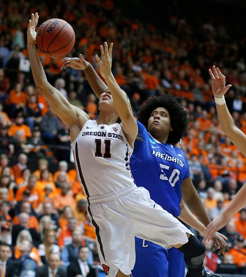 Oregon State's Gabriella Hanson (11) has her shot blocked by Creighton's Brianna Rollerson (50) during the second half of a second-round game in the NCAA women's college basketball tournament Sunday, March 19, 2017, in Corvallis, Ore. Oregon State won 64-52. (AP Photo/Timothy J. Gonzalez)