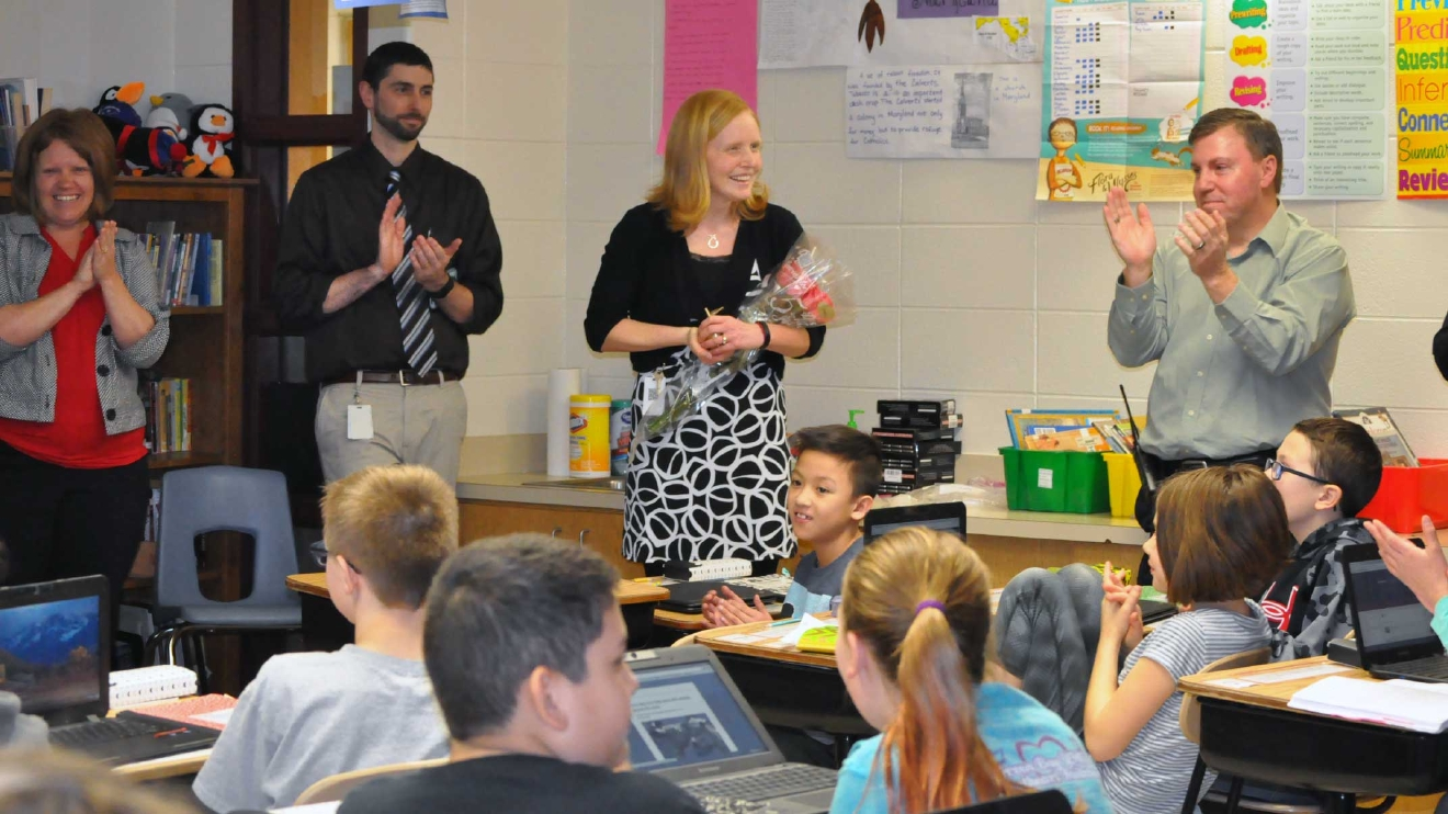 Sarah Yonts is surprised with a Golden Apple Award March 8, 2017, at Laura Ingalls Wilder Elementary School in Green Bay. (WLUK/Donna Fischer)