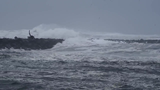 High surf sweeps over jetties, moves logs at mouth of Siuslaw River
