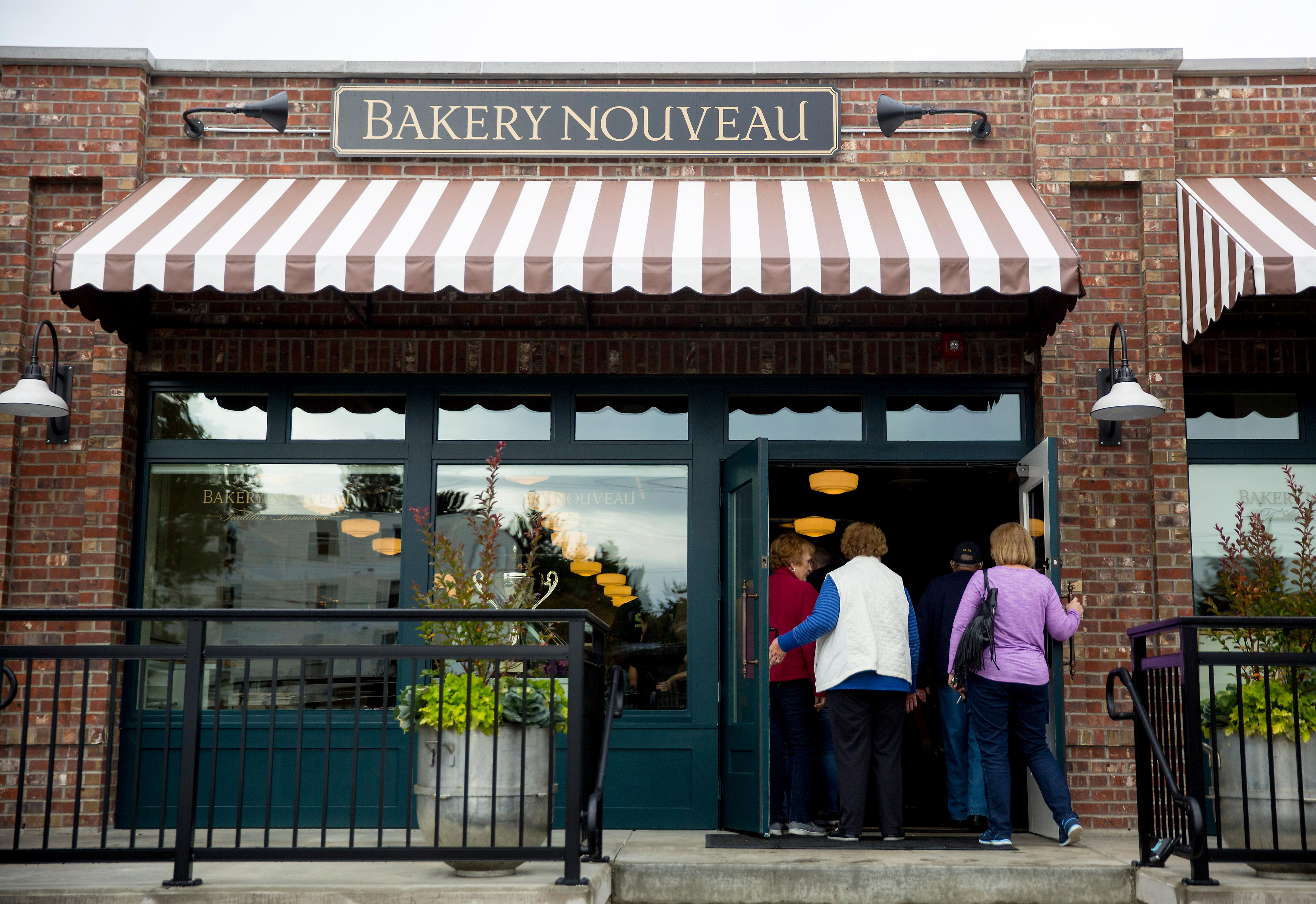 The co-owners of Bakery Nouveau, chef William Leaman and CEO Heather Leaman, just opened their newest cafe AND flagship store in Burien this week. The bakery and cafe is the third location of the iconic eatery, after it's West Seattle and Capitol Hill locations. The new flagship shop is their largest, at nearly 7,500 square-feet with seating for 22 inside and about 12 outside. They'll be open daily serving pastries, cakes, and breads—as well as house-made gelato and savory options. The new shop houses much-expanded chocolate production, which guests can get a glimpse of through a window in the floor. They can also take a peek at bakers laminating dough and finishing up chocolate confections up on the main level, where there are plenty of peek-a-boo views of the action. Bakery Nouveau is located at 426 SW 153rd Street in Burien, Washington. (Image: Sy Bean / Seattle Refined)
