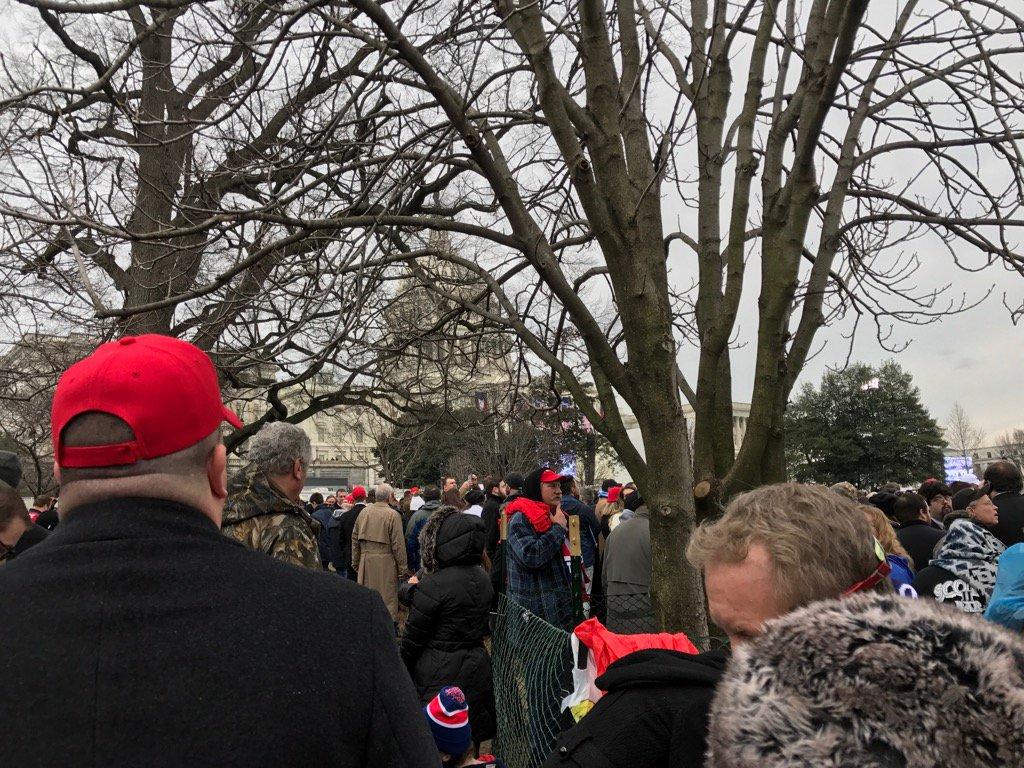 In the cold and rain, Trump supporters await inaugural address Friday, January 20, 2016. (Sinclair Broadcast Group)