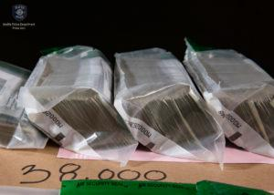 Police and special agents arrested 12 people and seized large quantities of narcotics, along with guns and $60,000 in cash after a drug trafficking bust at a Belltown nightclub on Wednesday, August 8, 2018. (Photo: to Seattle Police)