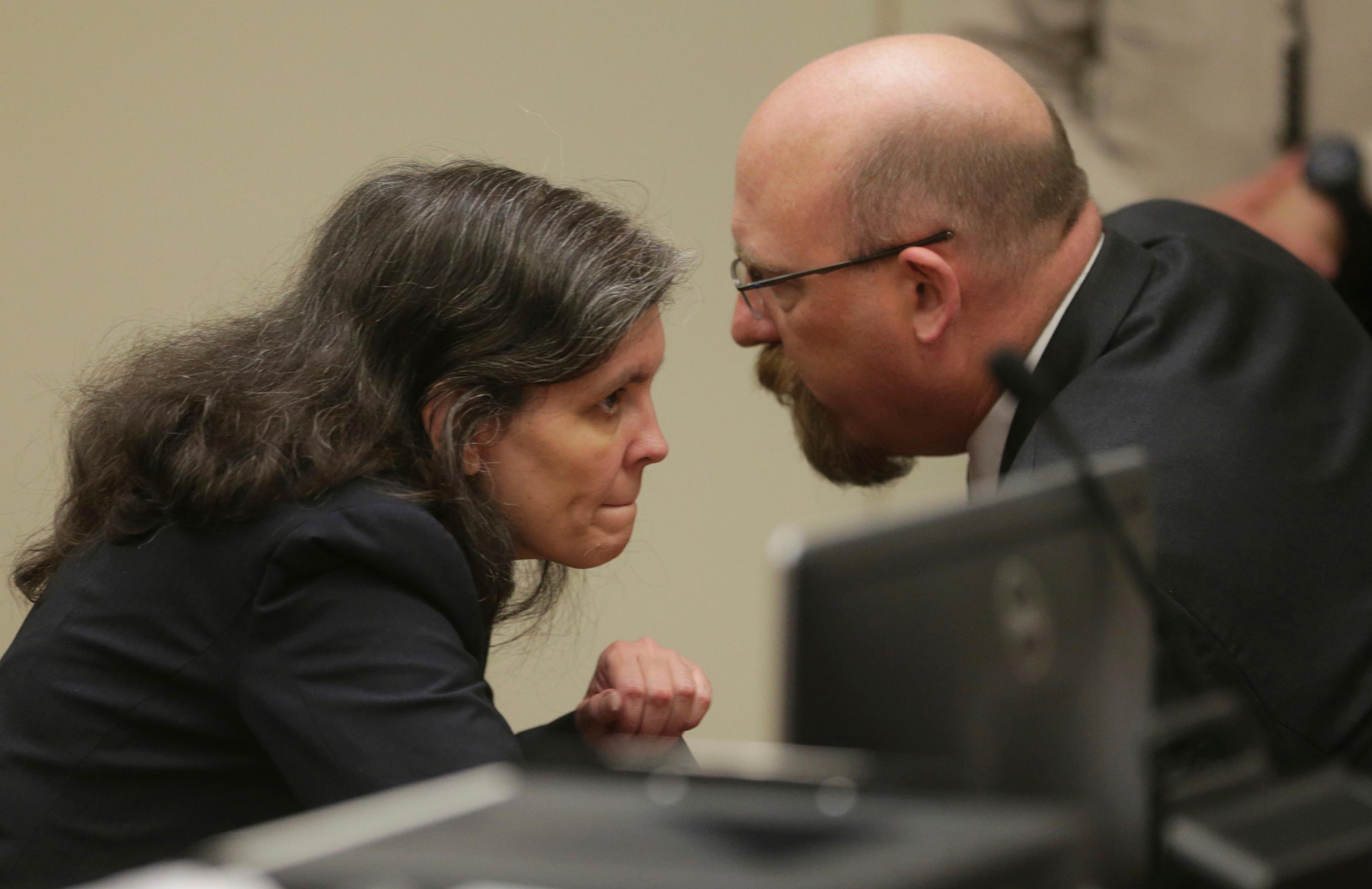 Louise Turpin, left, and her attorney, Jeff Moore, appear in court for a conference about their case in Riverside, Calif., Friday, Feb. 23, 2018. A California couple already accused of starving and shackling some of their 13 children has pleaded not guilty to new charges of child abuse. David and Louise Turpin entered pleas Friday to three new charges of abuse and Louise Turpin also pleaded not guilty to a count of felony assault. (Watchara Phomicinda/The Press Enterprise via AP, Pool)