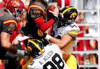 In this Sept. 9, 2017, file photo, Iowa State quarterback Jacob Park (10) is sacked by Iowa defenders Anthony Nelson (98) and A.J. Epenesa (94) during the first half of a game, in Ames, Iowa.