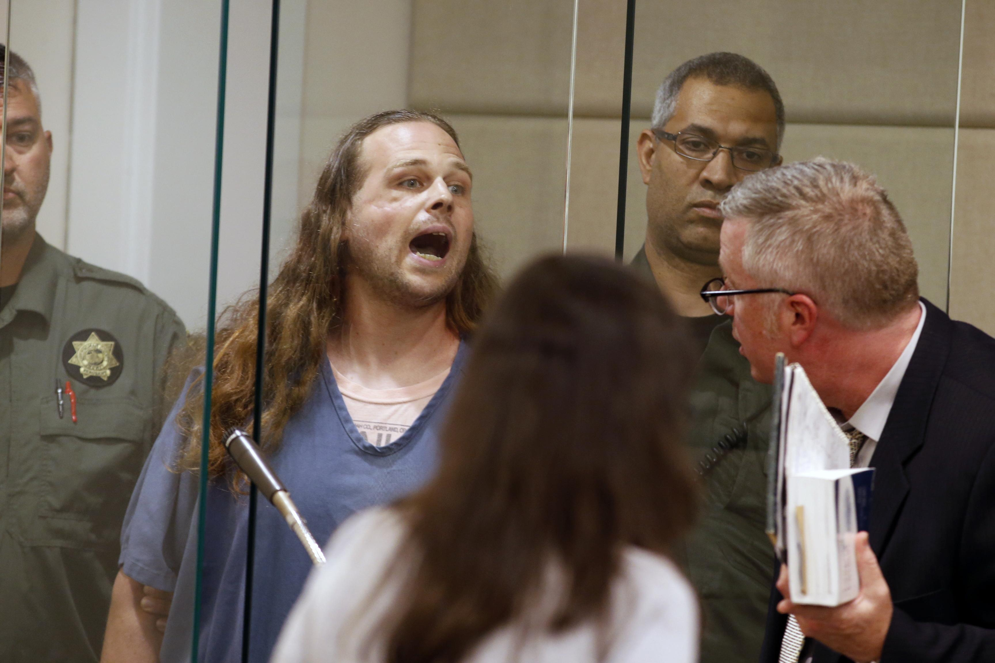 Jeremy Joseph Christian shouts as he is arraigned Tuesday in Multnomah County Circuit Court in Portland. [Beth Nakamura/The Oregonian via AP, Pool]