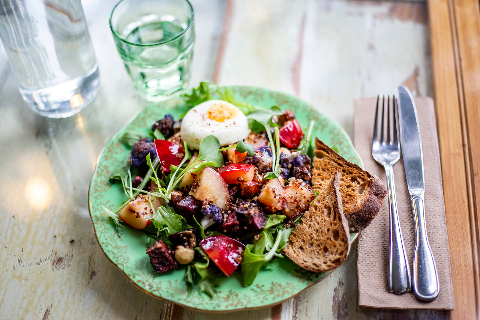 "The Fall Roasted Breakfast Salad with mixed greens with house lemon-orange vinaigrette, maple roasted rosemary hazelnuts, quinoa, beets, heirloom cauliflower and crispy kale with a poached egg. Cafe Mia features seasonal, locally-sourced and ethical cuisine - every dish is prepared in house by Mia herself. Cafe Mia is tucked away near the West Seattle Junction on SW Oregon Street. The perfect spot for brunch after hitting the farmers market on Sunday! Find them on Instagram{&nbsp;}<a  href=""https://www.instagram.com/cafe.mia/?hl=en"" target=""_blank"" title=""https://www.instagram.com/cafe.mia/?hl=en"">@cafe.mia</a>. (Image:{&nbsp;}Samantha Witt / Seattle Refined)"