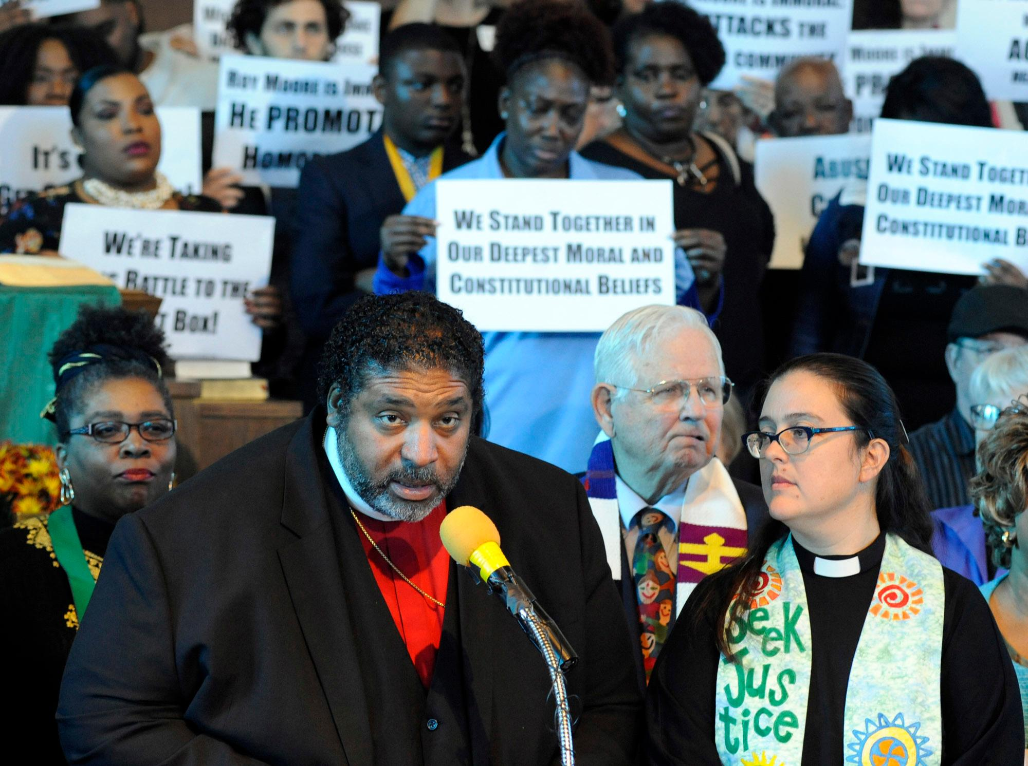 The Rev. William J. Barber  speaks at a rally in opposition to Republican U.S. Senate candidate Roy Moore at a church in Birmingham, Ala., on Saturday, Nov. 18, 2017.  Barber and other speakers criticized Moore over allegations he made improper sexual advances toward teenage girls decades ago.  (AP Photo/Jay Reeves)