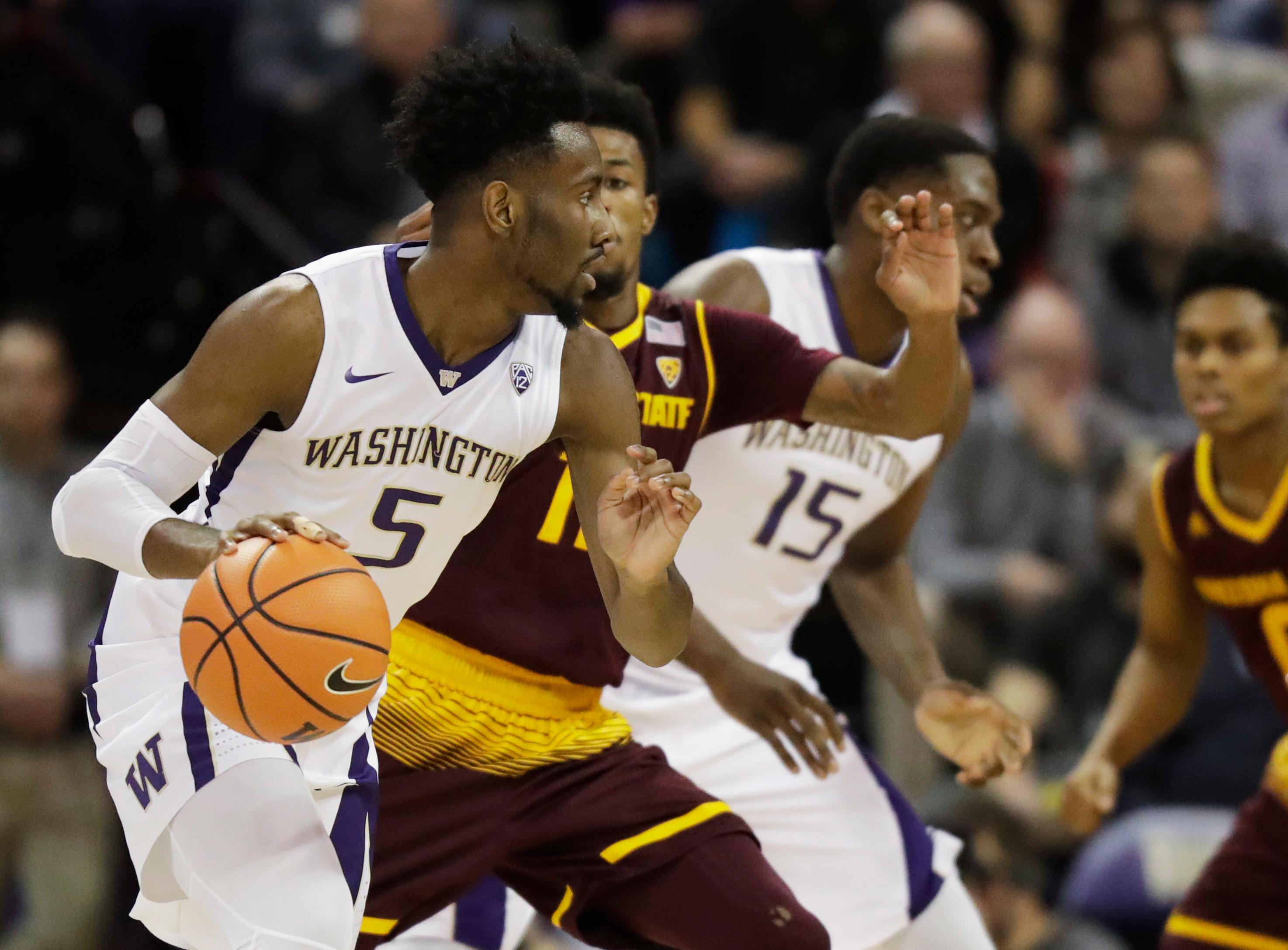 Washington guard Jaylen Nowell (5) drives past Arizona State guard Shannon Evans II, second from left, in the first half of an NCAA college basketball game, Thursday, Feb. 1, 2018, in Seattle. (AP Photo/Ted S. Warren)