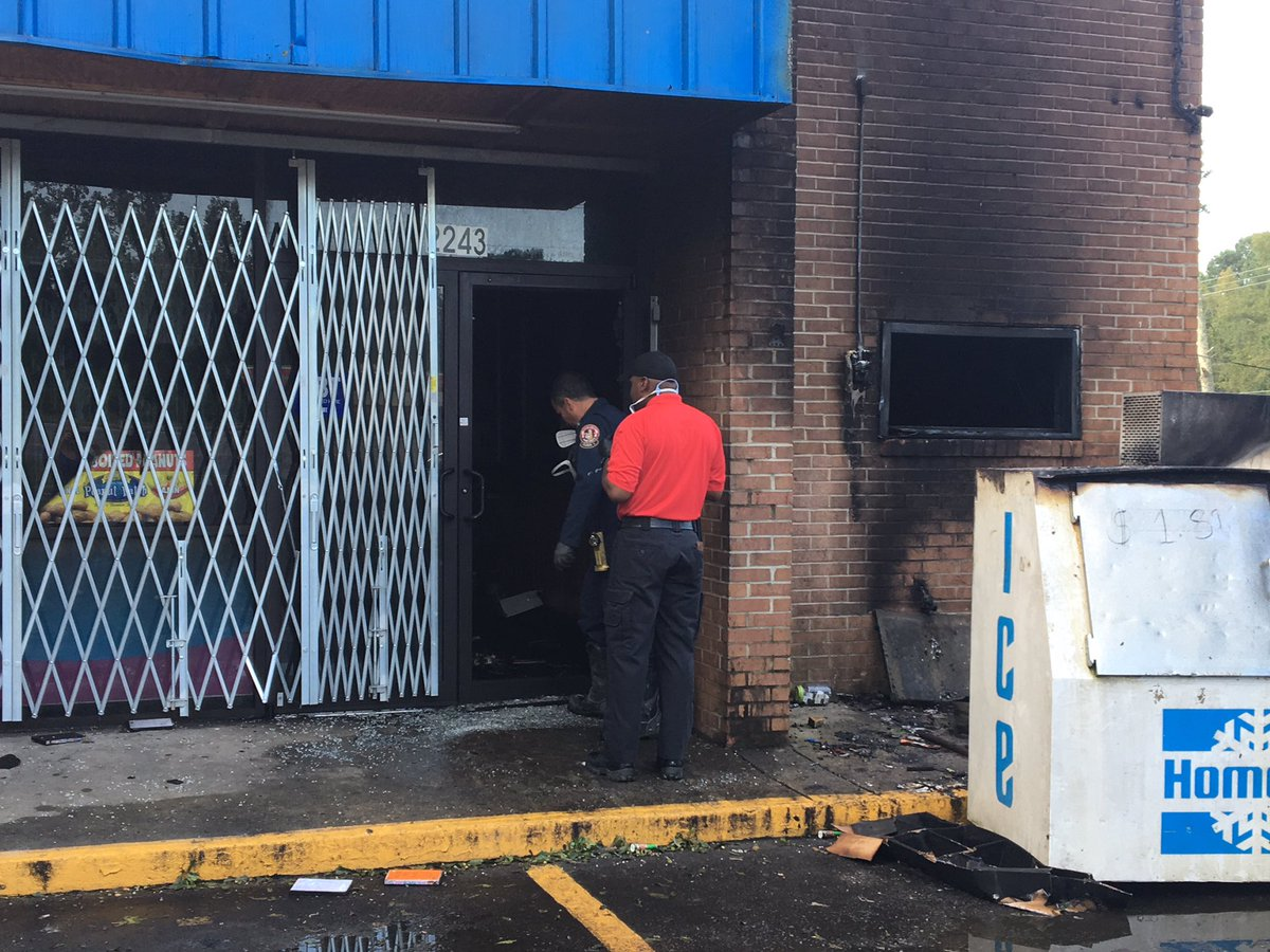 Early Wednesday morning Macon-Bibb fire crews fought to put out a blaze at the  Pacecar Express convenience store in East Macon.  / Emily Swecker (WGXA)