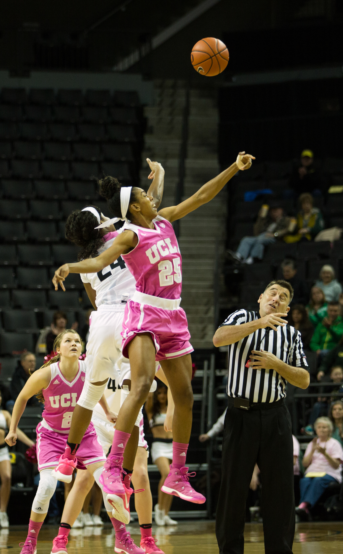 Oregon Ducks forward Ruthy Heard (#24) and UCLA forward Monique Billings (#25) jump for the tip off. The Oregon Ducks defeated the No. 15 UCLA Bruins 84-75 Friday evening at Matthew Knight Arena in Eugene, Oregon.  Photo by Duncan Moore, Oregon News Lab