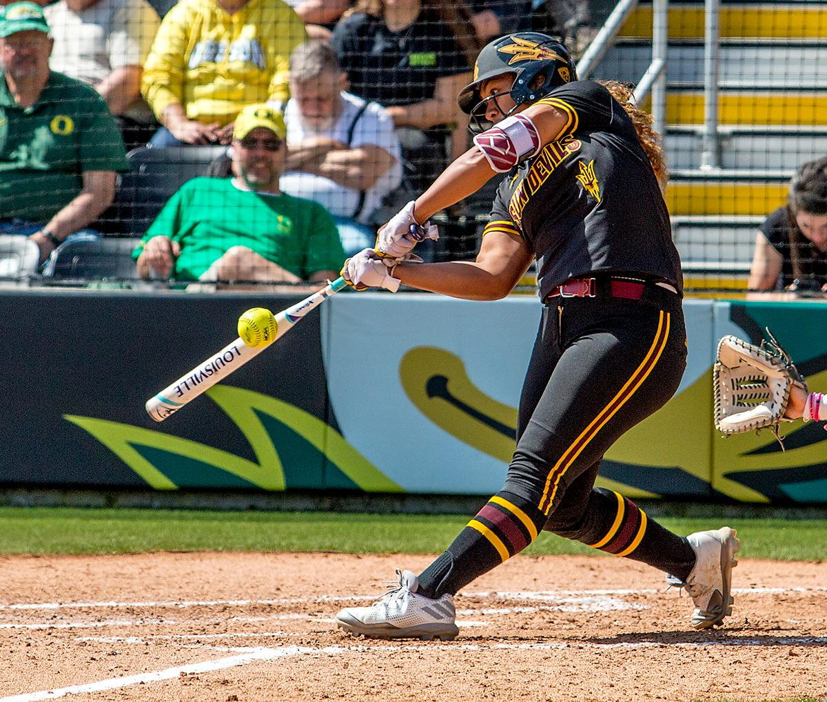 The Sun Devils' Ulufa Leilua (#9) connects with the ball. The Oregon Ducks Softball team took their third win over the Arizona Sun Devils, 1-0, in the final game of the weekends series that saw the game go into an eighth inning before the Duck?s Mia Camuso (#7) scored a hit allowing teammate Haley Cruse (#26) to run into home plate for a point. The Ducks are now 33-0 this season and will next play a double header against Portland State on Tuesday, April 4 at Jane Sanders Stadium. Photo by August Frank, Oregon News Lab