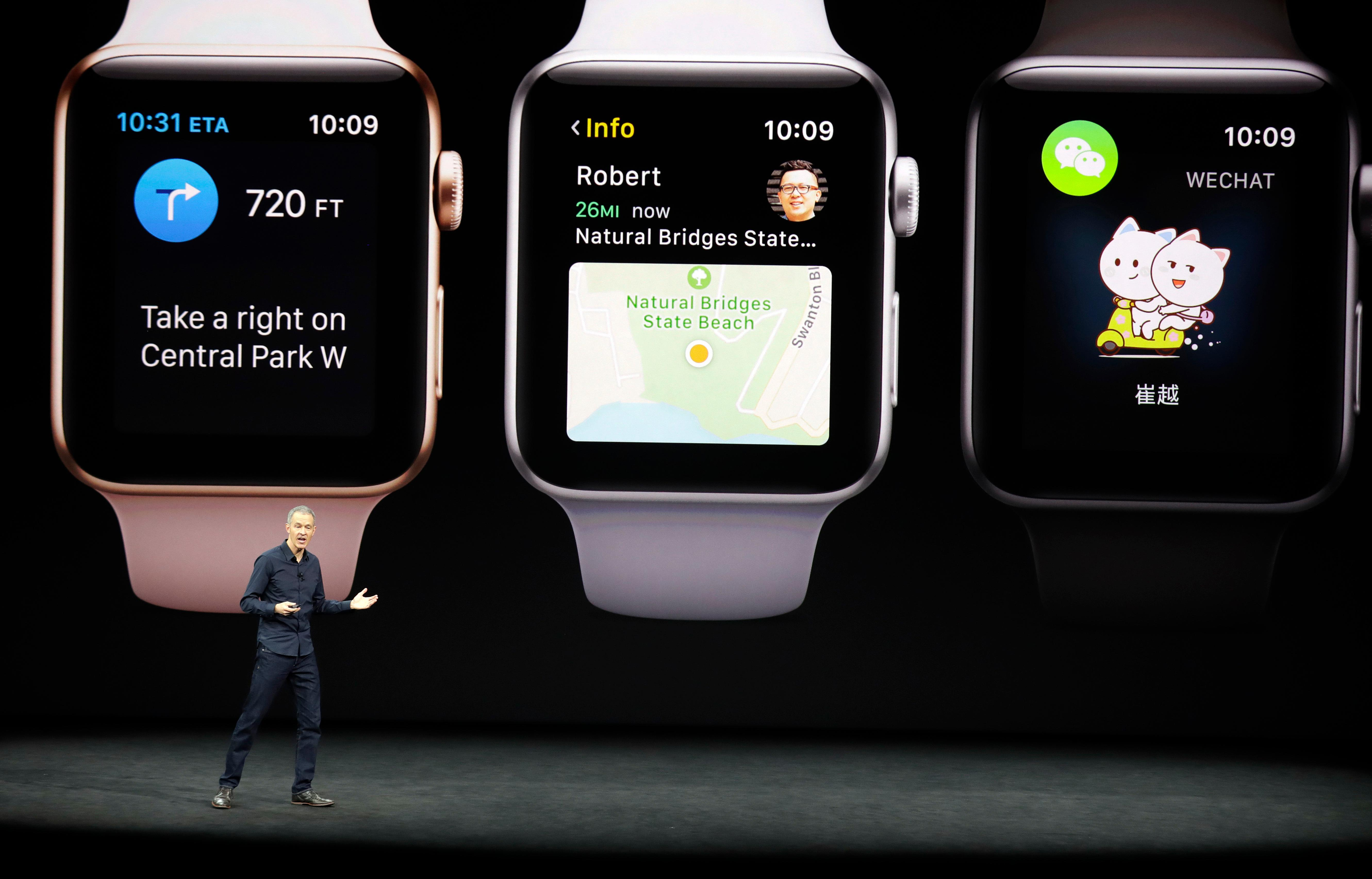 Jeff Williams, Apple's chief operating officer, shows new Apple Watch products at the Steve Jobs Theater on the new Apple campus on Tuesday, Sept. 12, 2017, in Cupertino, Calif. (AP Photo/Marcio Jose Sanchez)