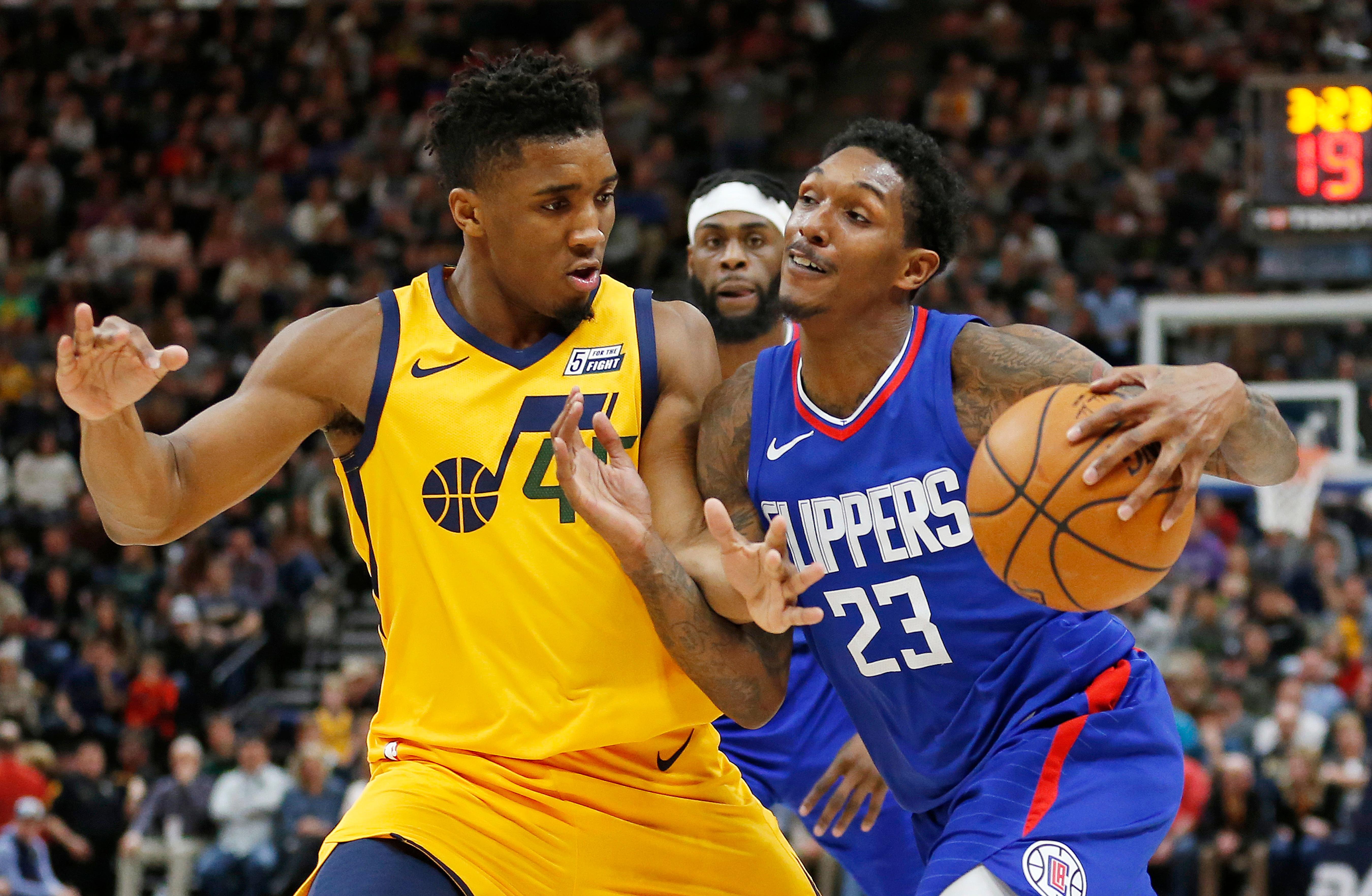 Utah Jazz guard Donovan Mitchell, left, guards Los Angeles Clippers guard Lou Williams (23) in the first half during an NBA basketball game Saturday, Jan. 20, 2018, in Salt Lake City. (AP Photo/Rick Bowmer)