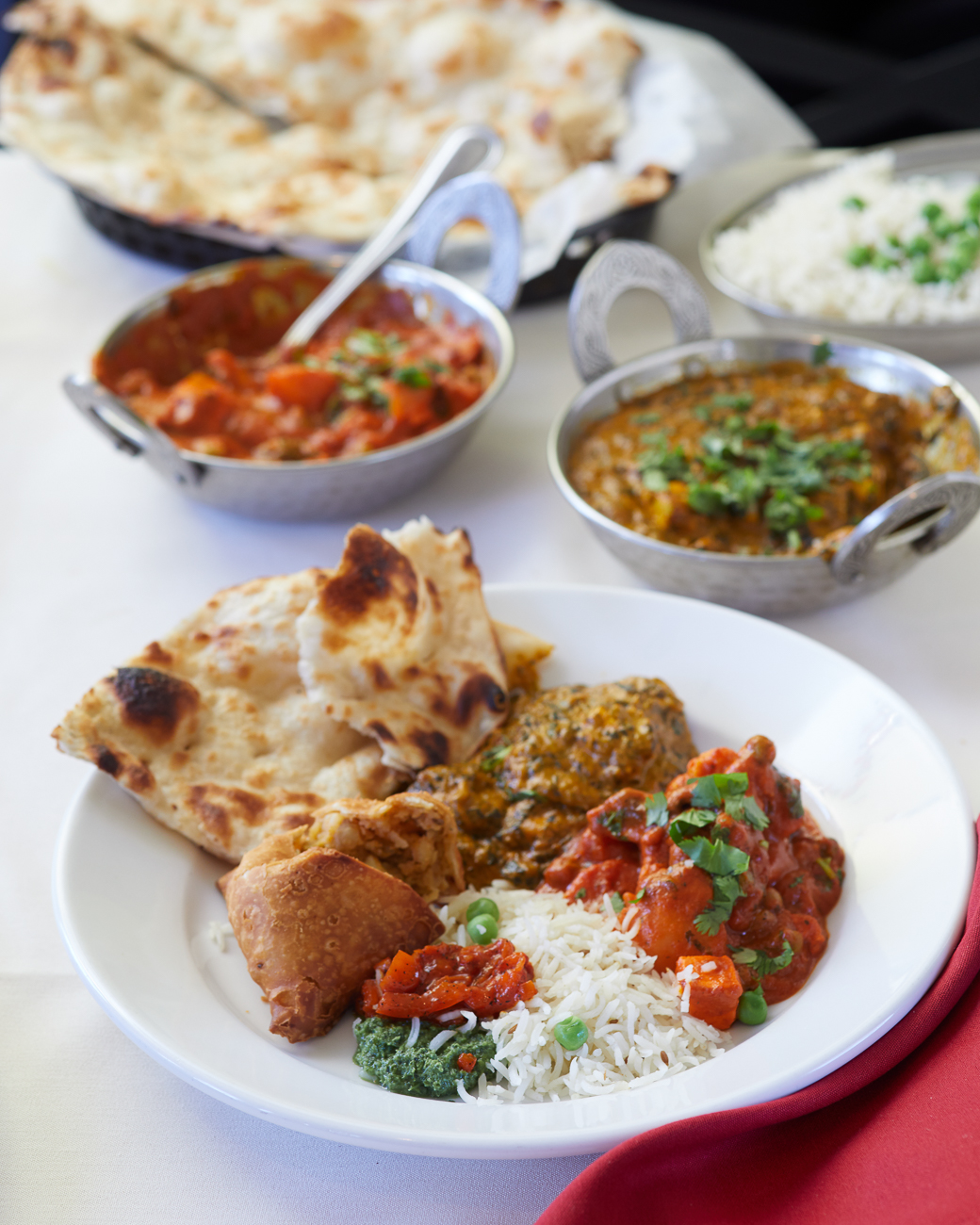 Vegetable Jalfreezi, samosa, saag paneer, and plain naan / Image: Marlene Rounds // Published: 8.4.18
