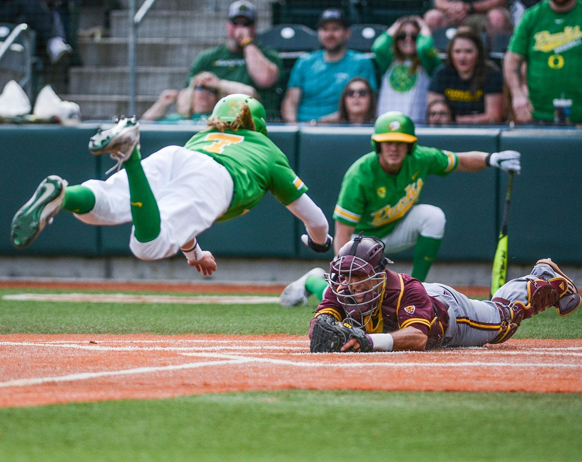 On the last play of the game Ducks outfielder Matthew Dyer (#7) tries to steal home while Sun Devils catcher Zach Cerbo (#30) meets him there to get the out. Despite a late comeback, the Ducks fall to Arizona State Sun Devils 4-3 in the second game of a three-game series. Photo by Jacob Smith, Oregon News Lab