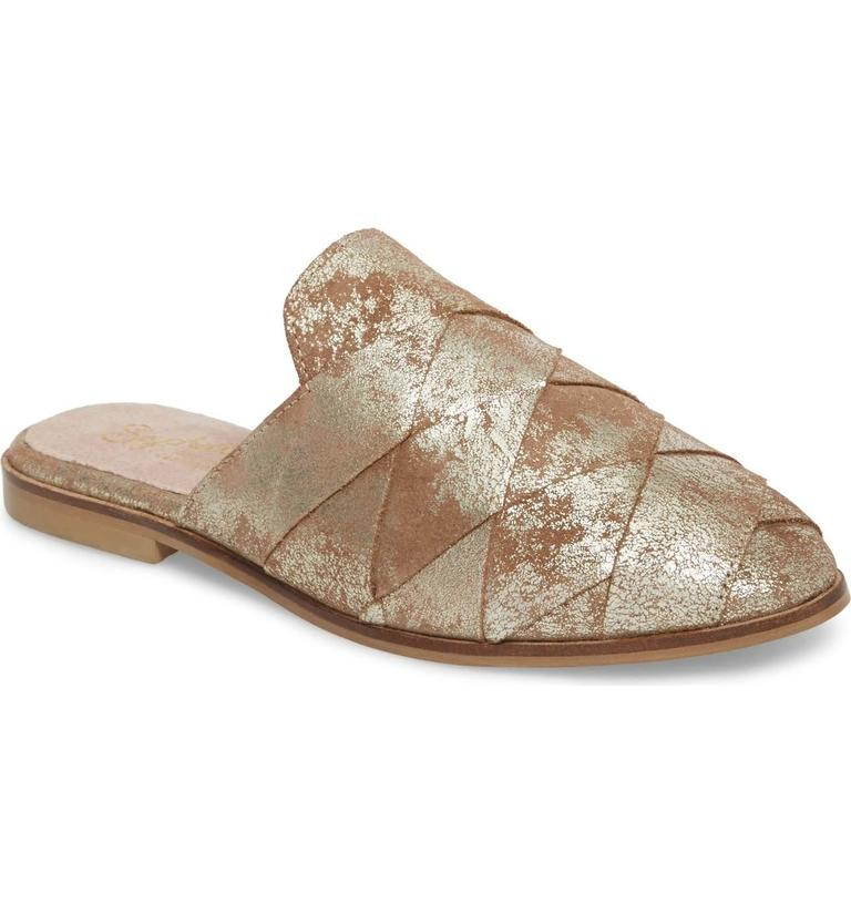 <p>Warning:{&amp;nbsp;} You are going to see these flats everywhere this spring.{&amp;nbsp;} I love these Mule/SEYCHELLES.{&amp;nbsp;}Wide leather straps are woven together to create a sophisticated, wear-anywhere mule. The gold is to die for. $99.95 at Nordstrom. (Image: Nordstrom){&amp;nbsp;}</p><p><br></p><p></p>